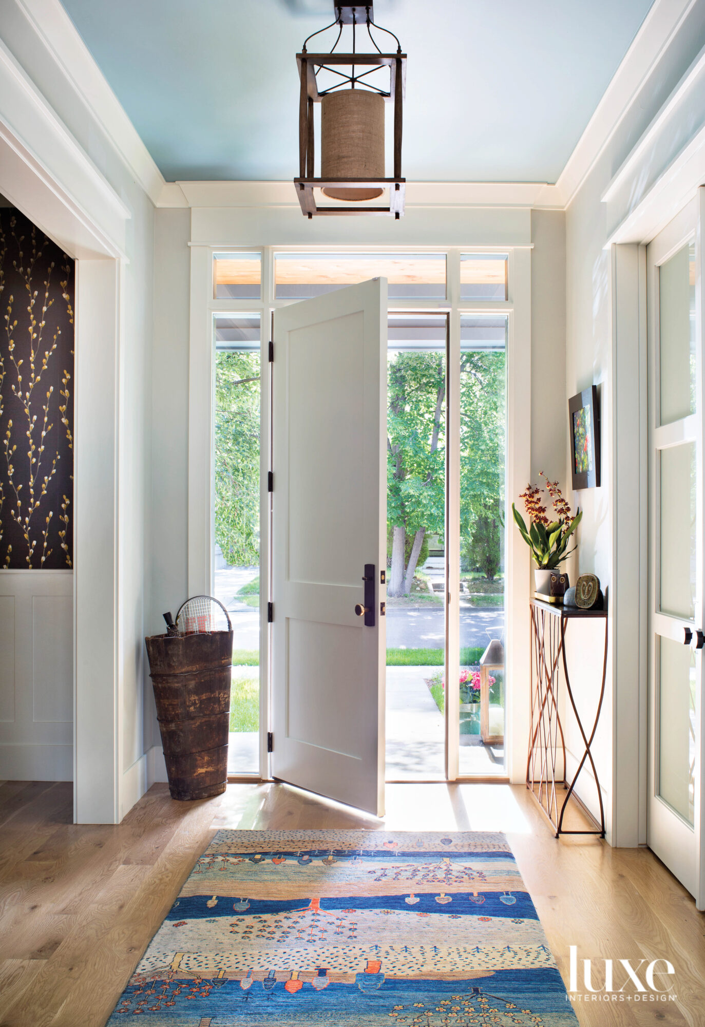 A light-filled entry has a...