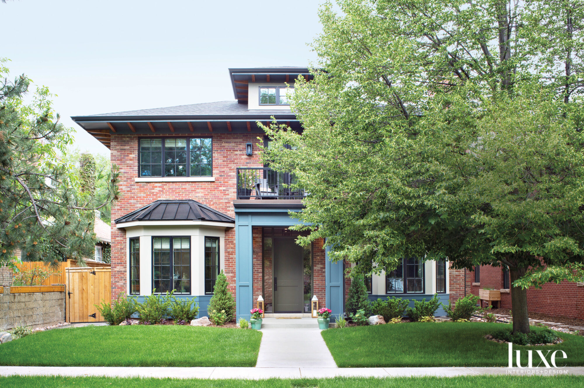 This Denver home has a brick exterior and an entrance with blue molding.