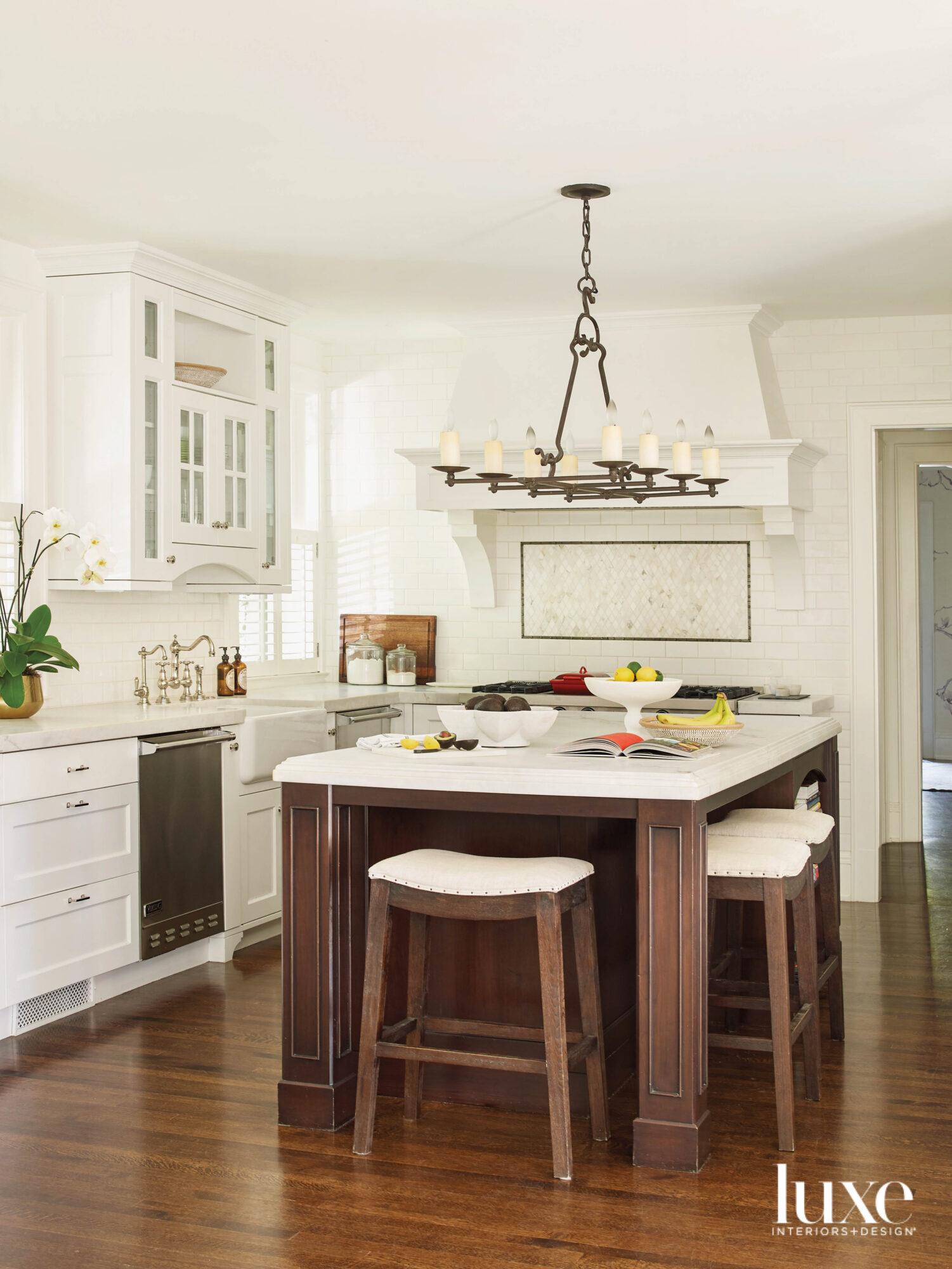 A white kitchen has a...