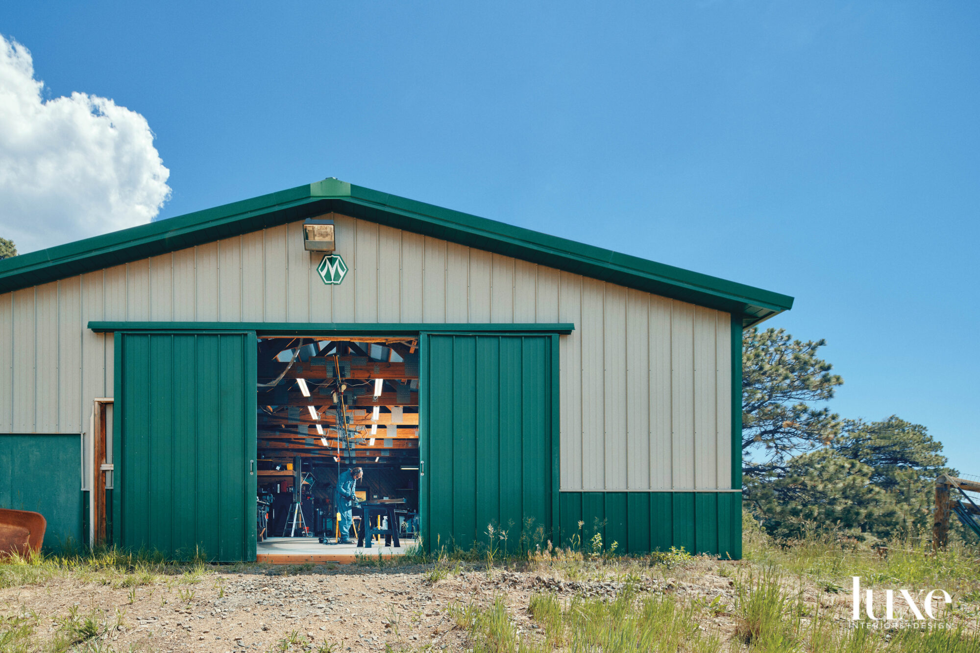 The exterior of one of the barns is cream and green colored.