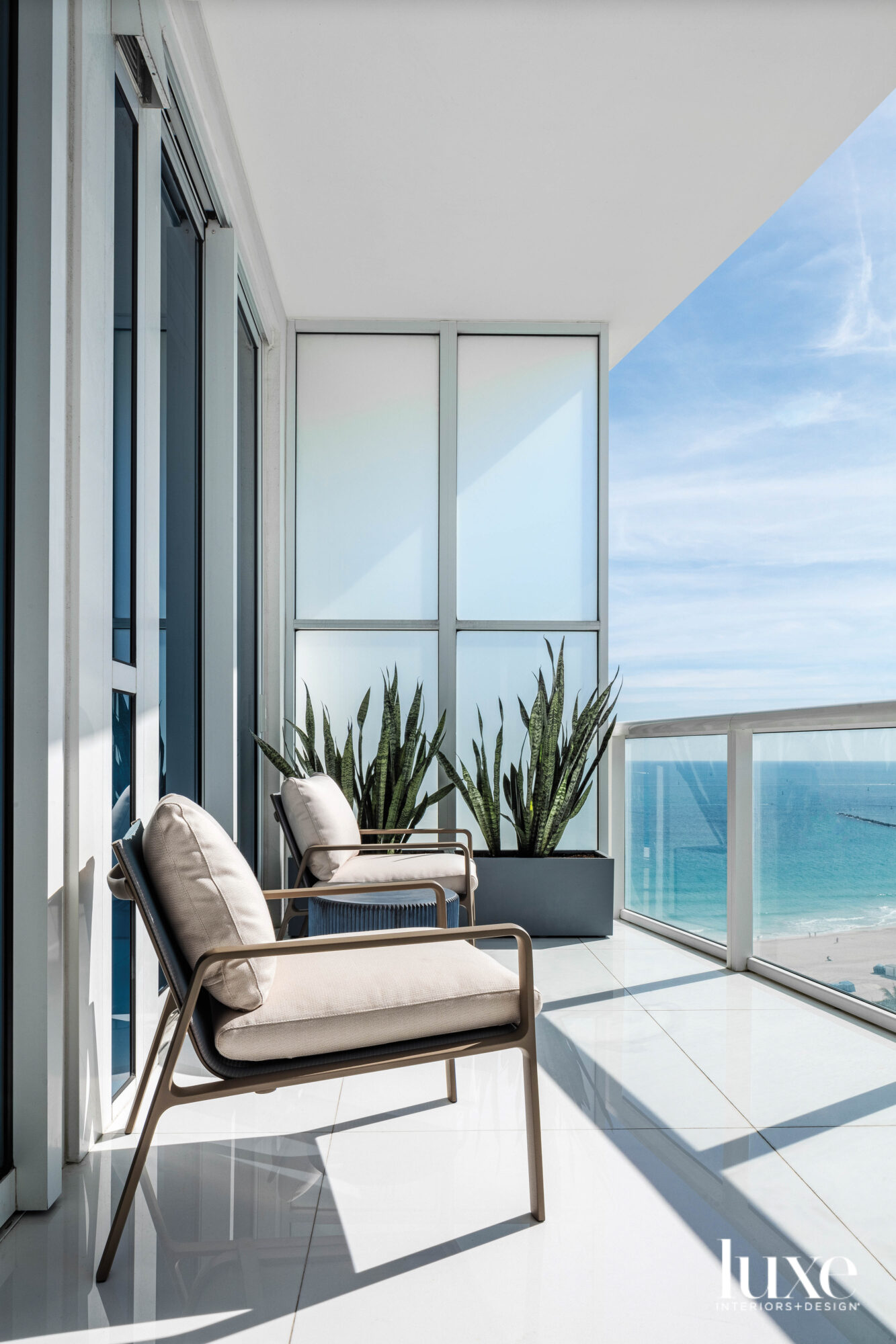 balcony with armchairs and ocean...