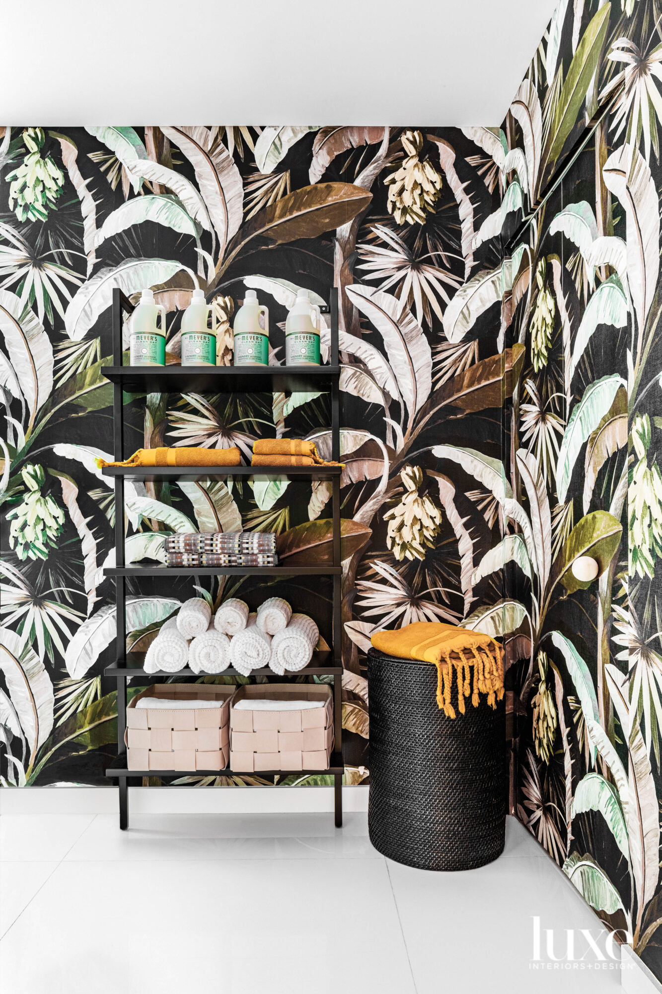 laundry room with dark tropical-print...