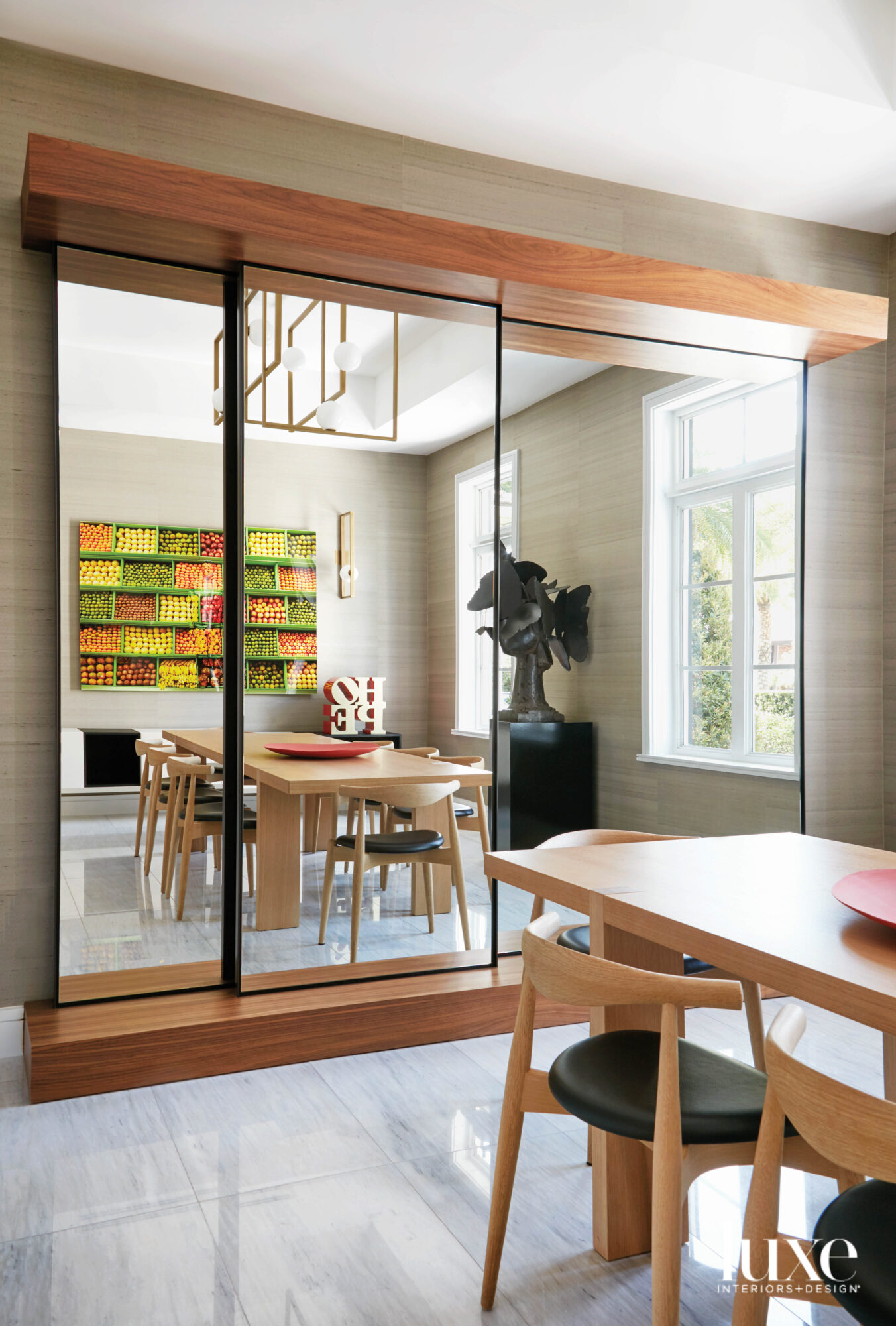 dining room with mirrored wall,...