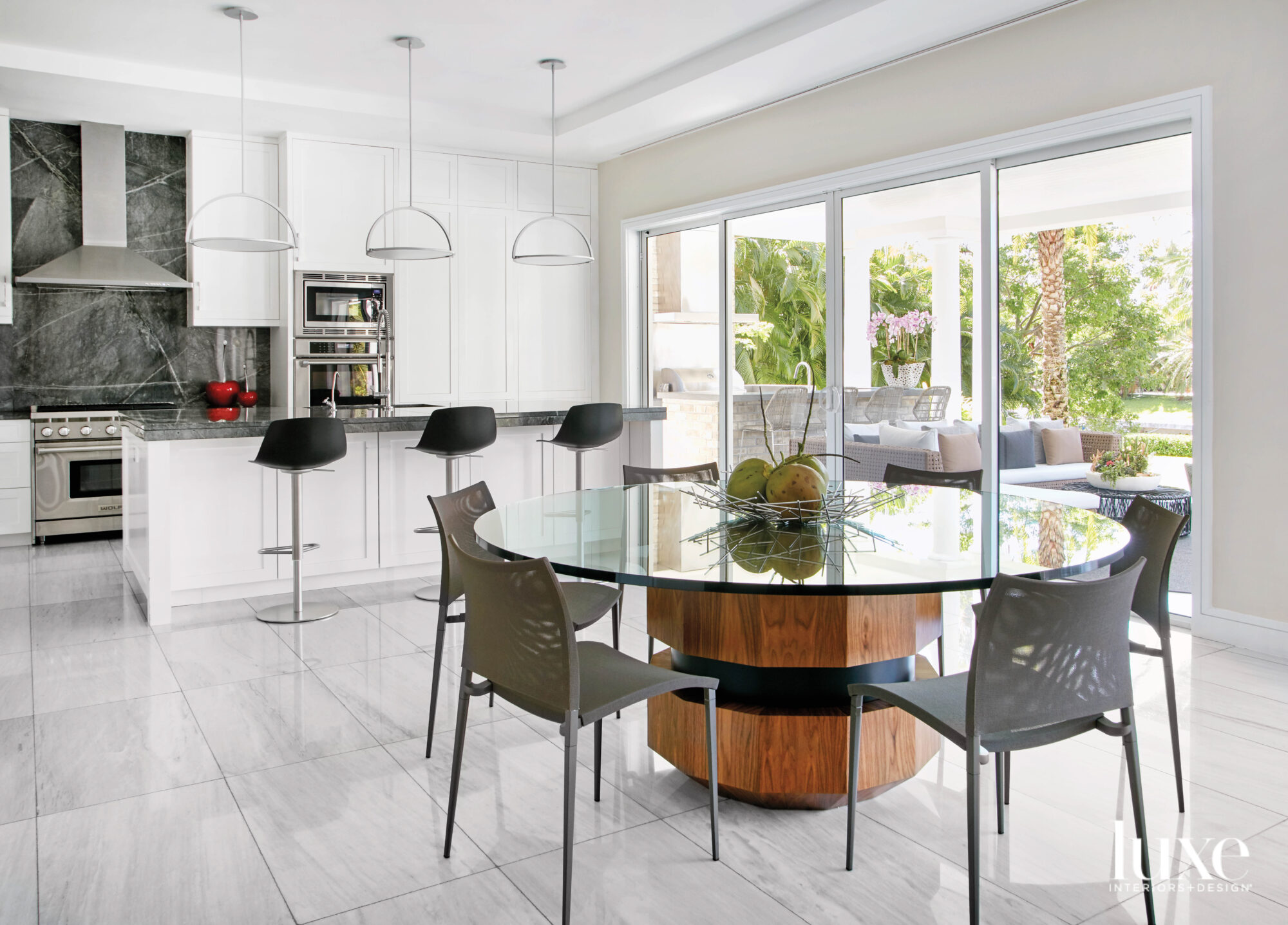 white kitchen with black barstools...