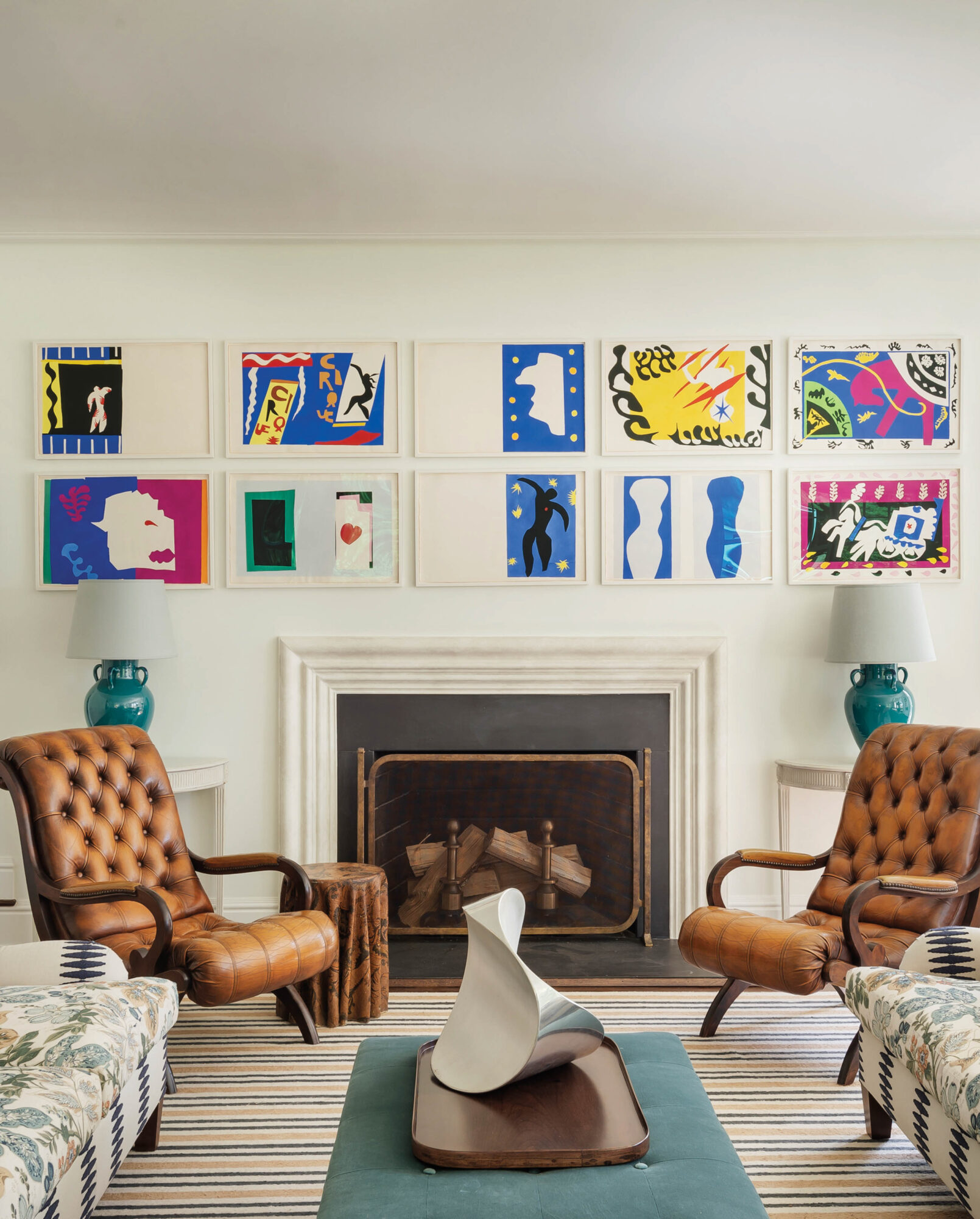 sitting area with leather armchairs and artwork