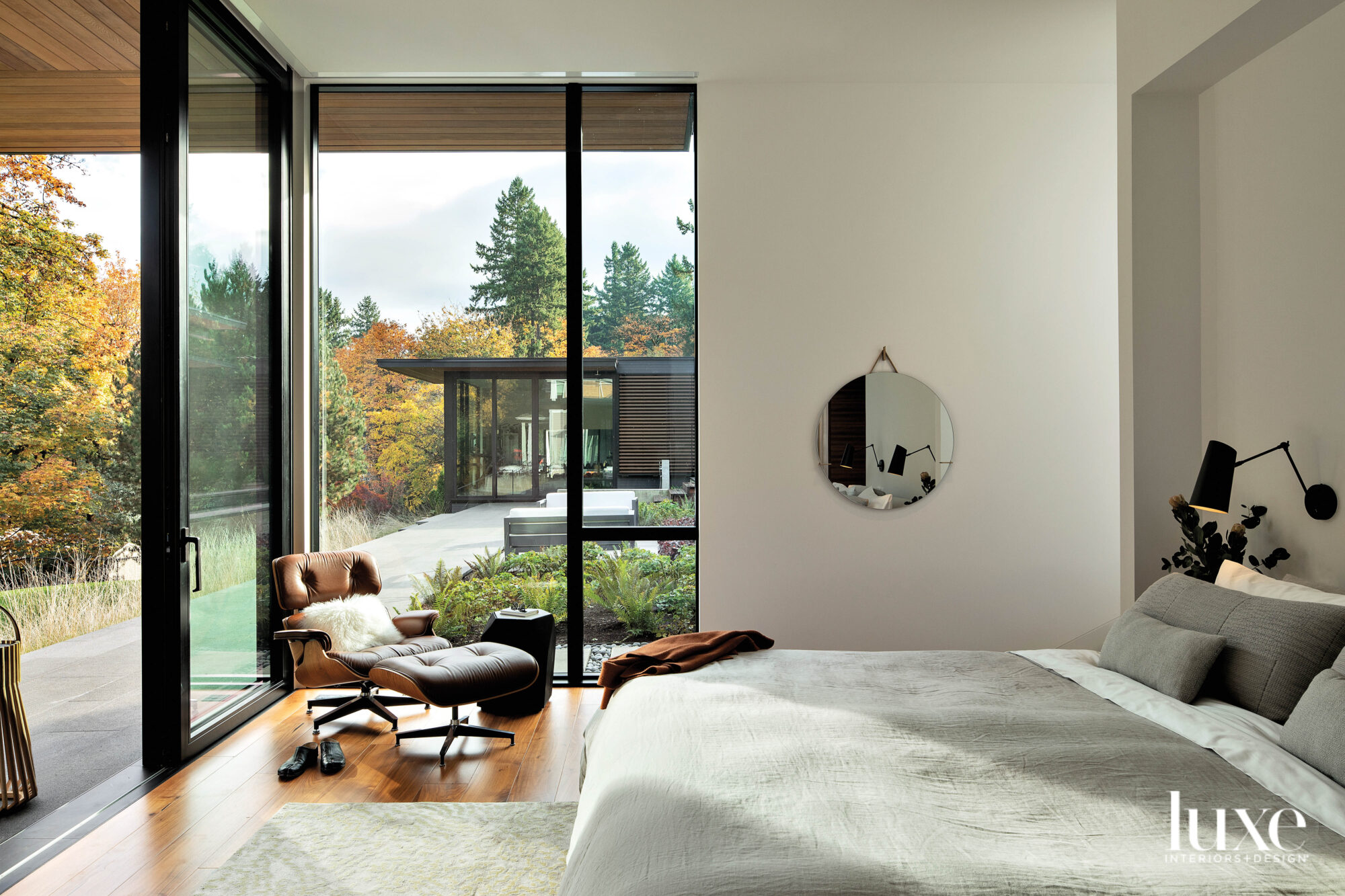 Bedroom with chair and bed and sliding doors