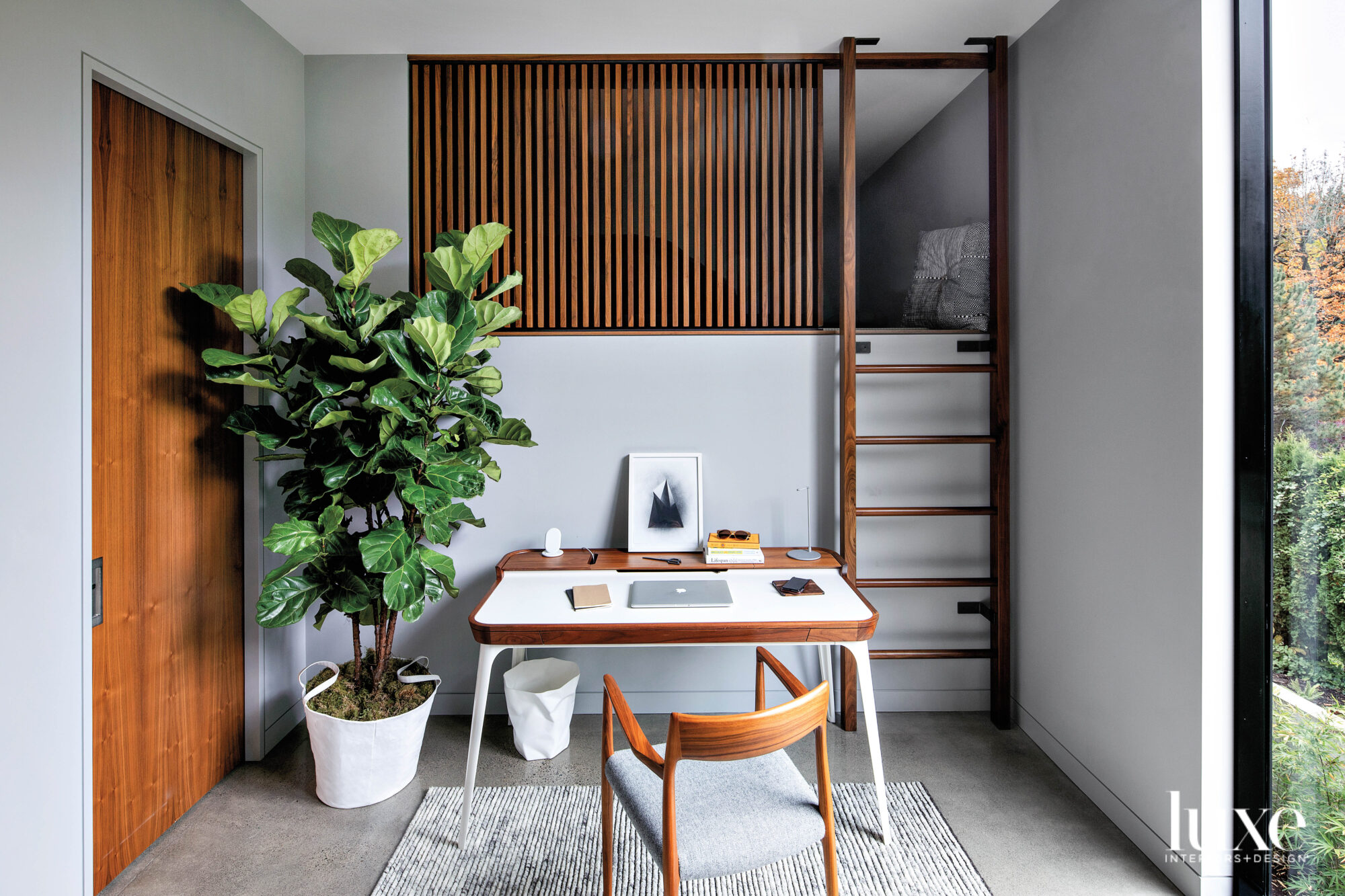 Room with desk and loft...