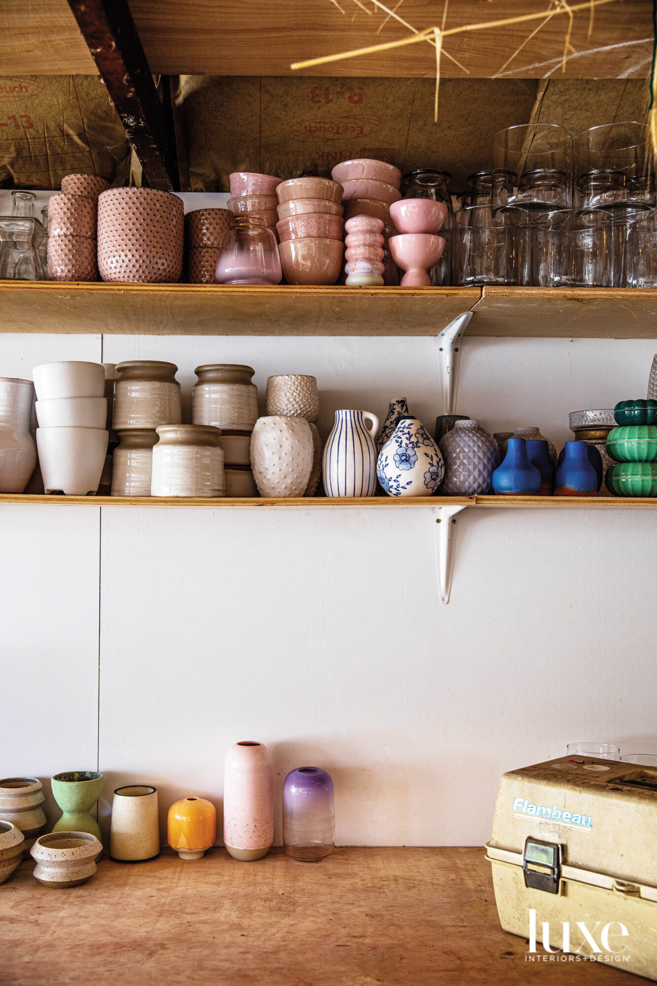 Shelves lined with colorful vases