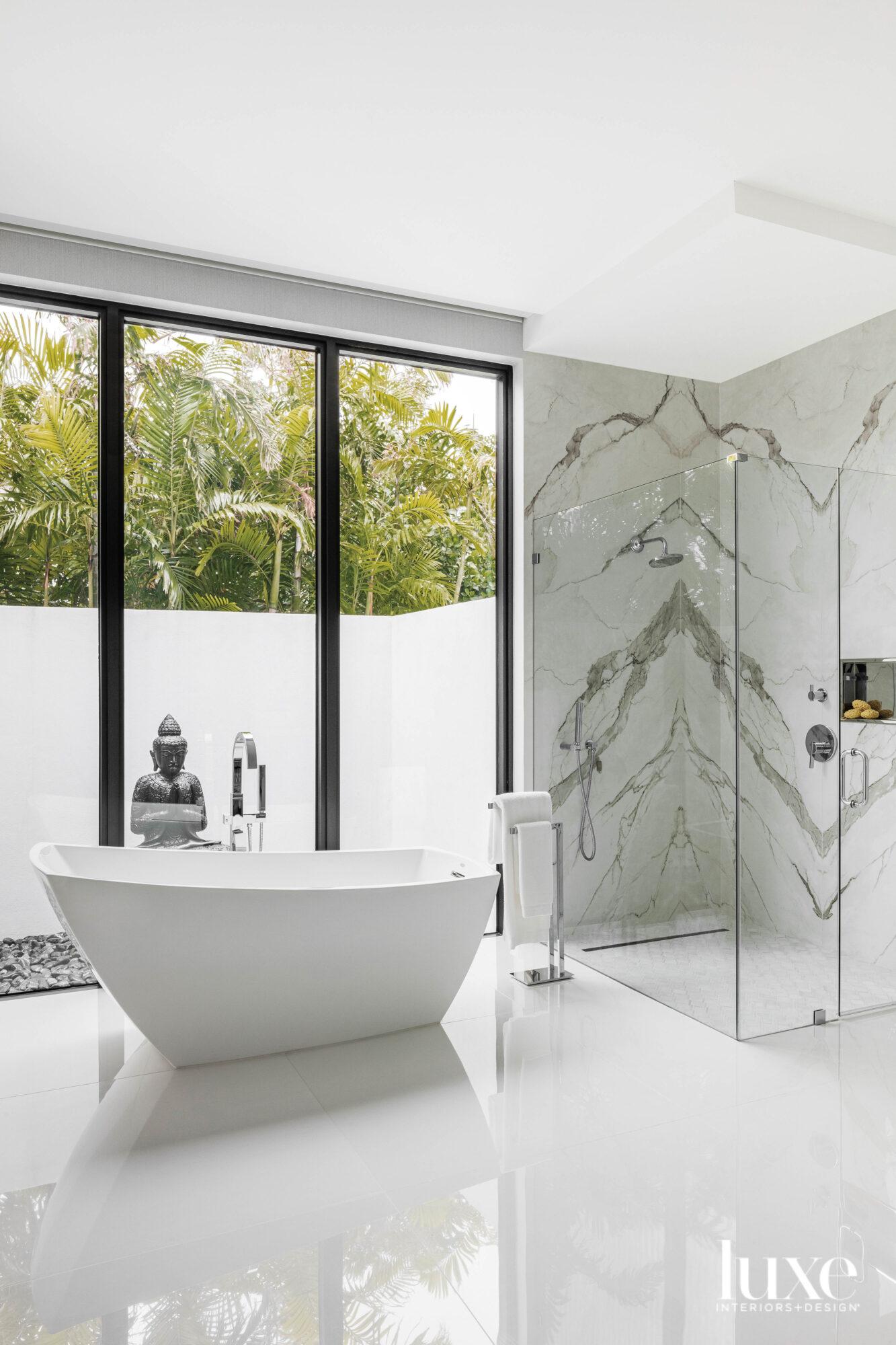 bathroom with freestanding white tub,...