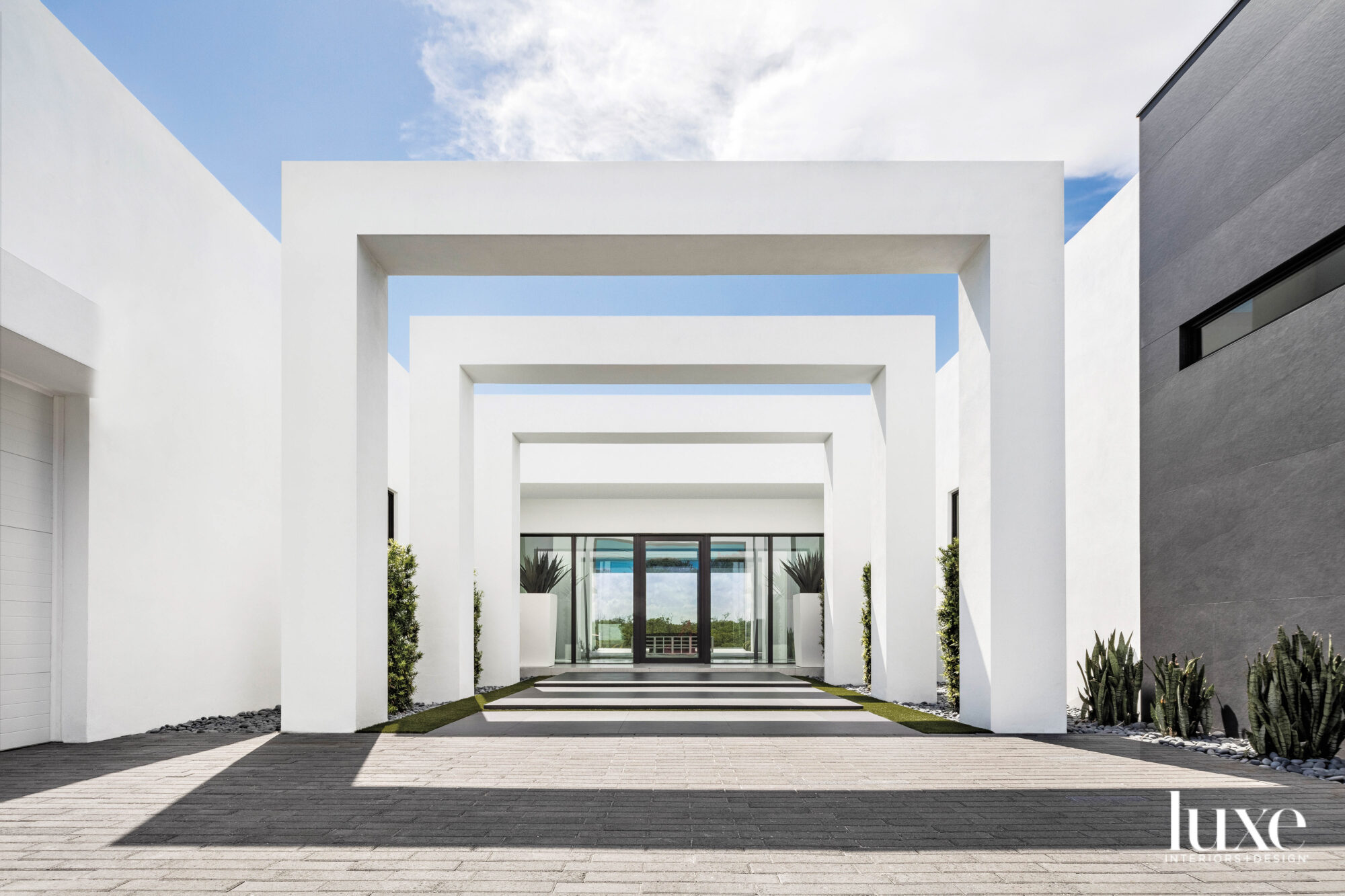 contemporary white house with three square portals at entry