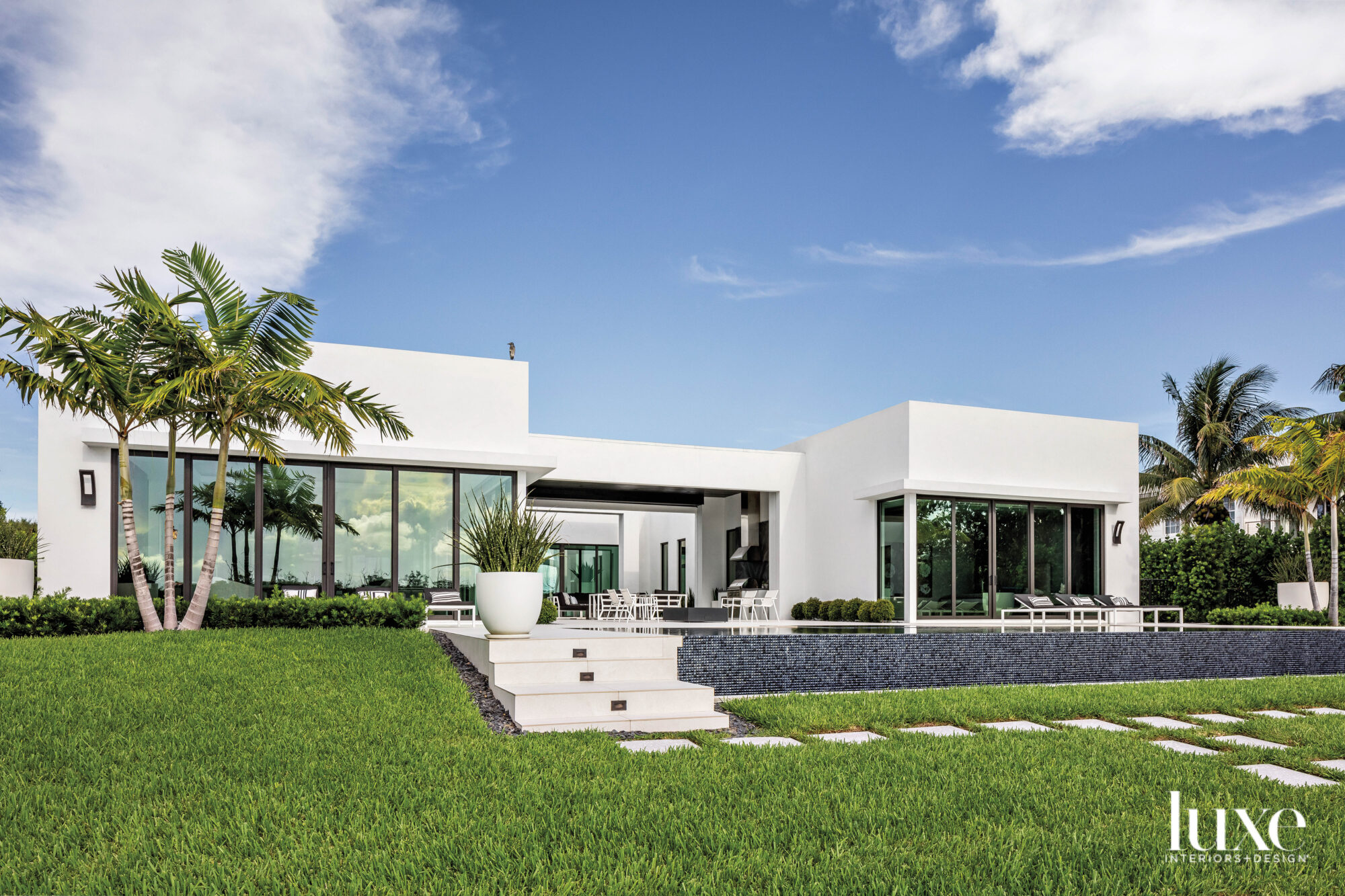 contemporary white one-story home with pool