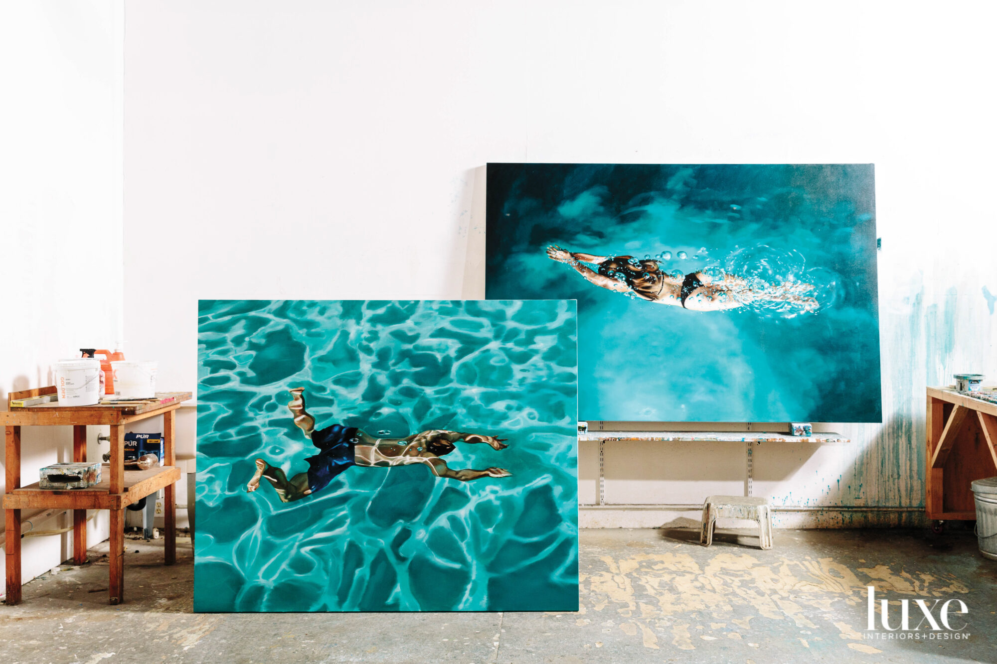 A pair of Zener's paintings show people swimming.