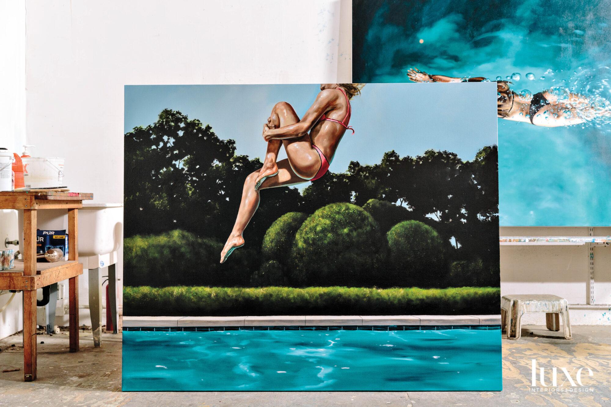 A painting shows a person leaping into a pool.