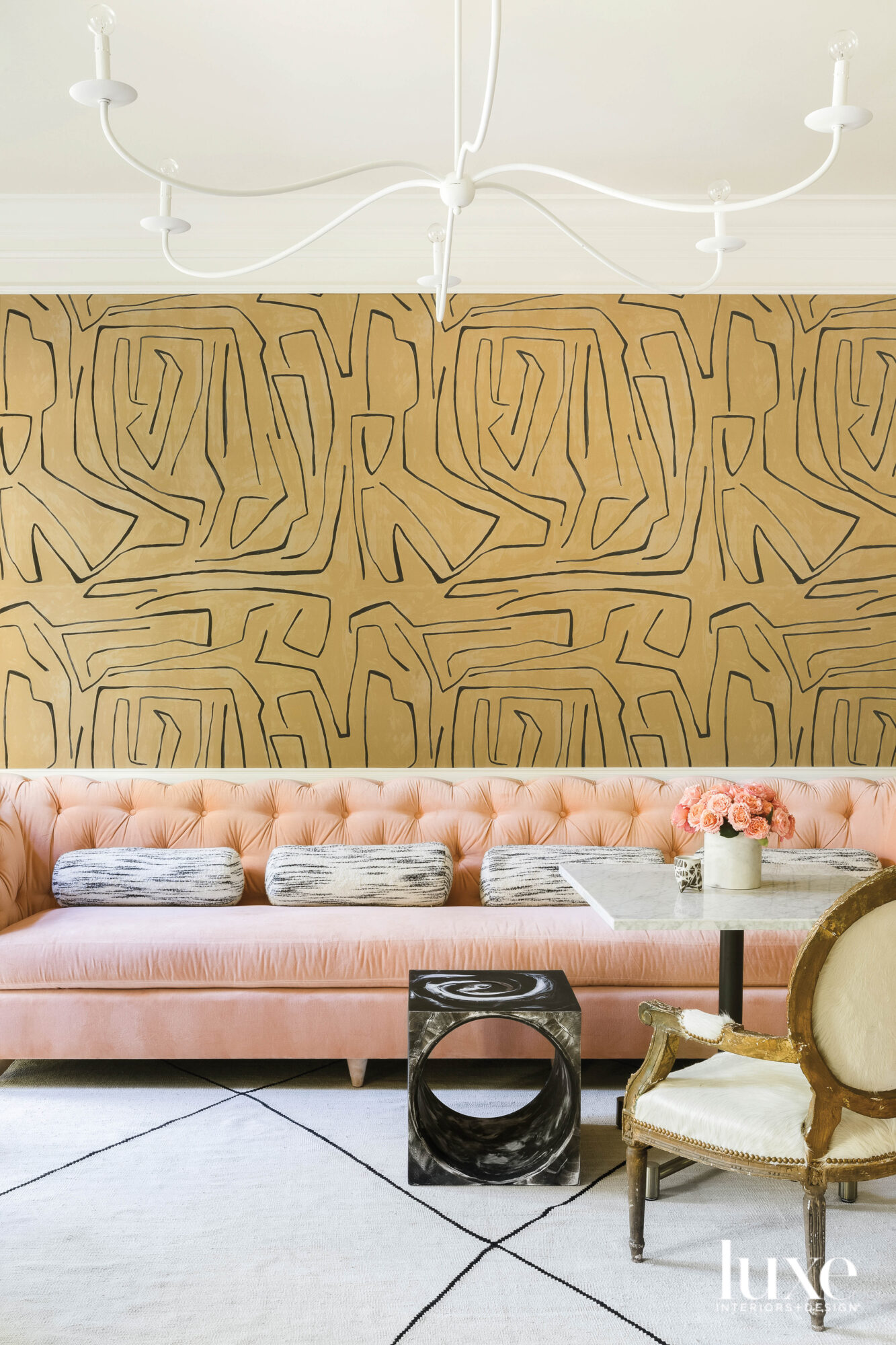 Tufted peach velvet banquette with...