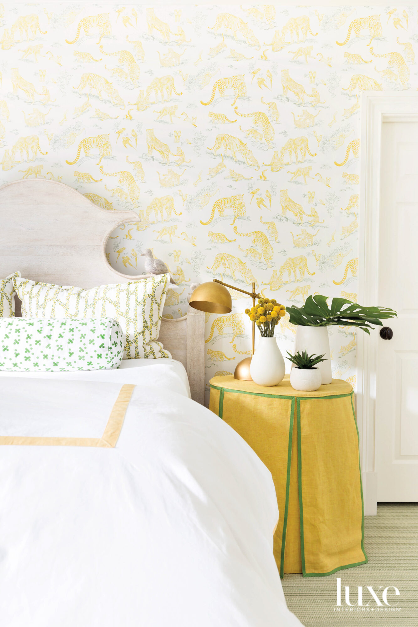 Photo of bed with yellow...