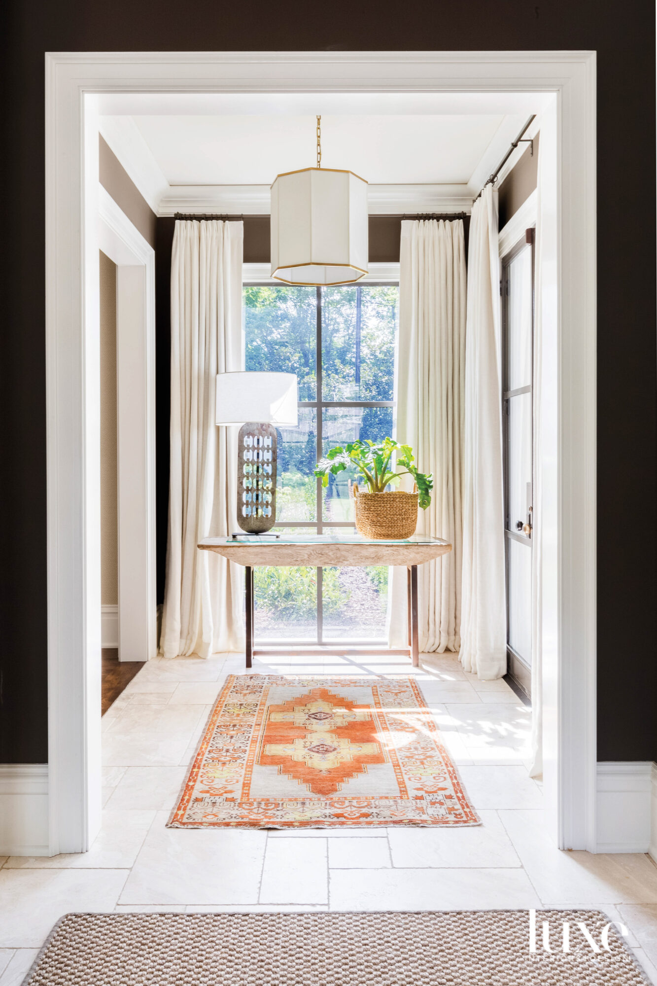 Hallway with orange rug, ivory...