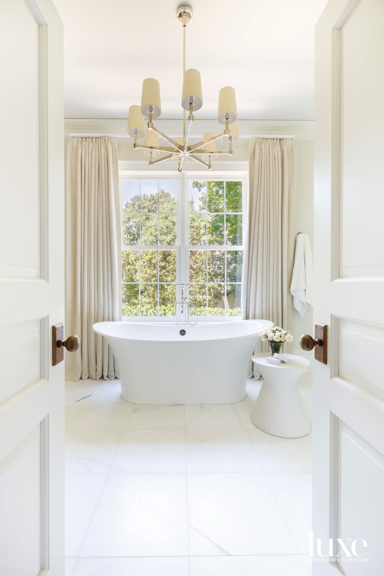 Pale neutral bathroom with standalone...