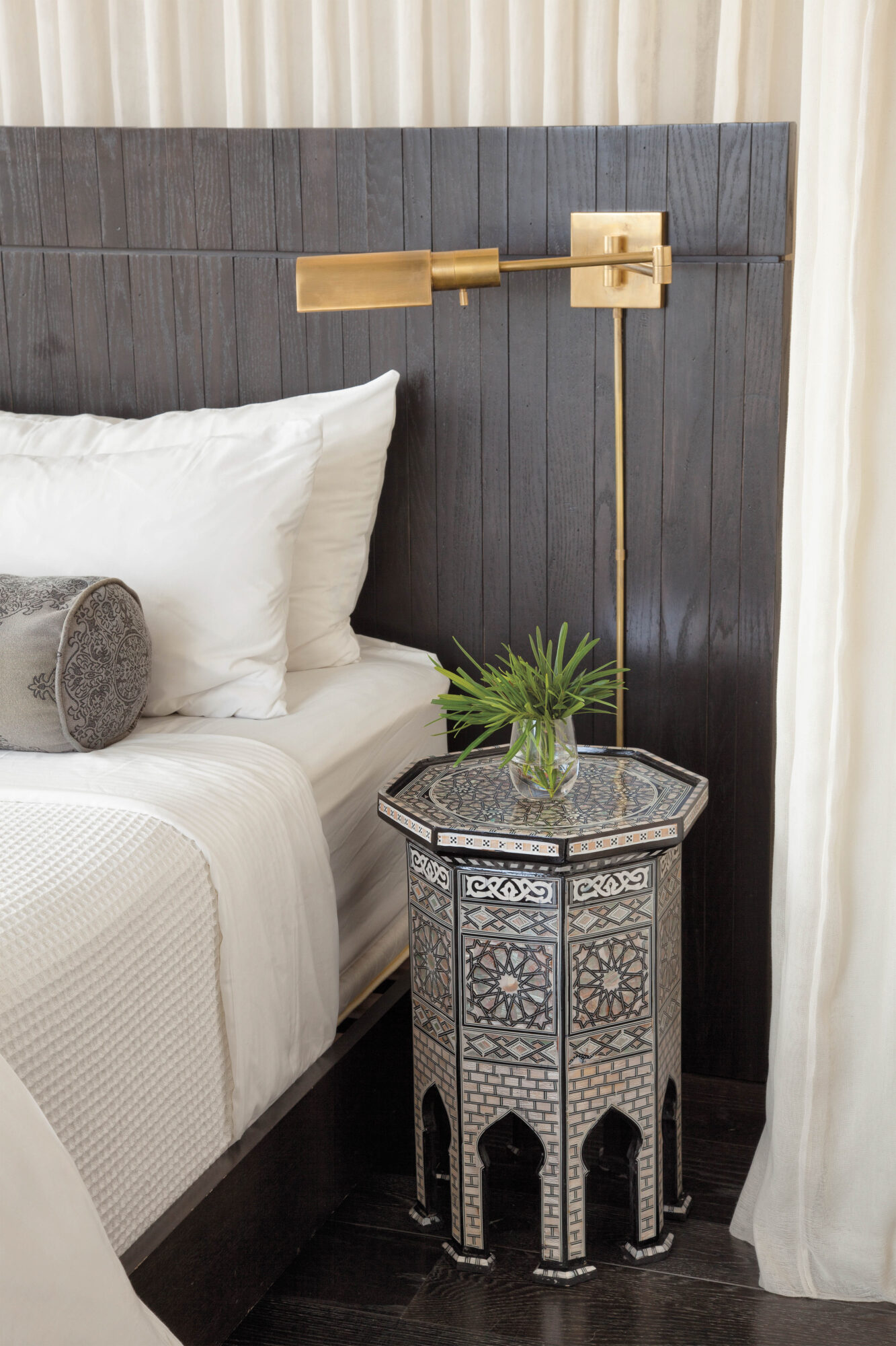 vignette of nightstand and side of bed