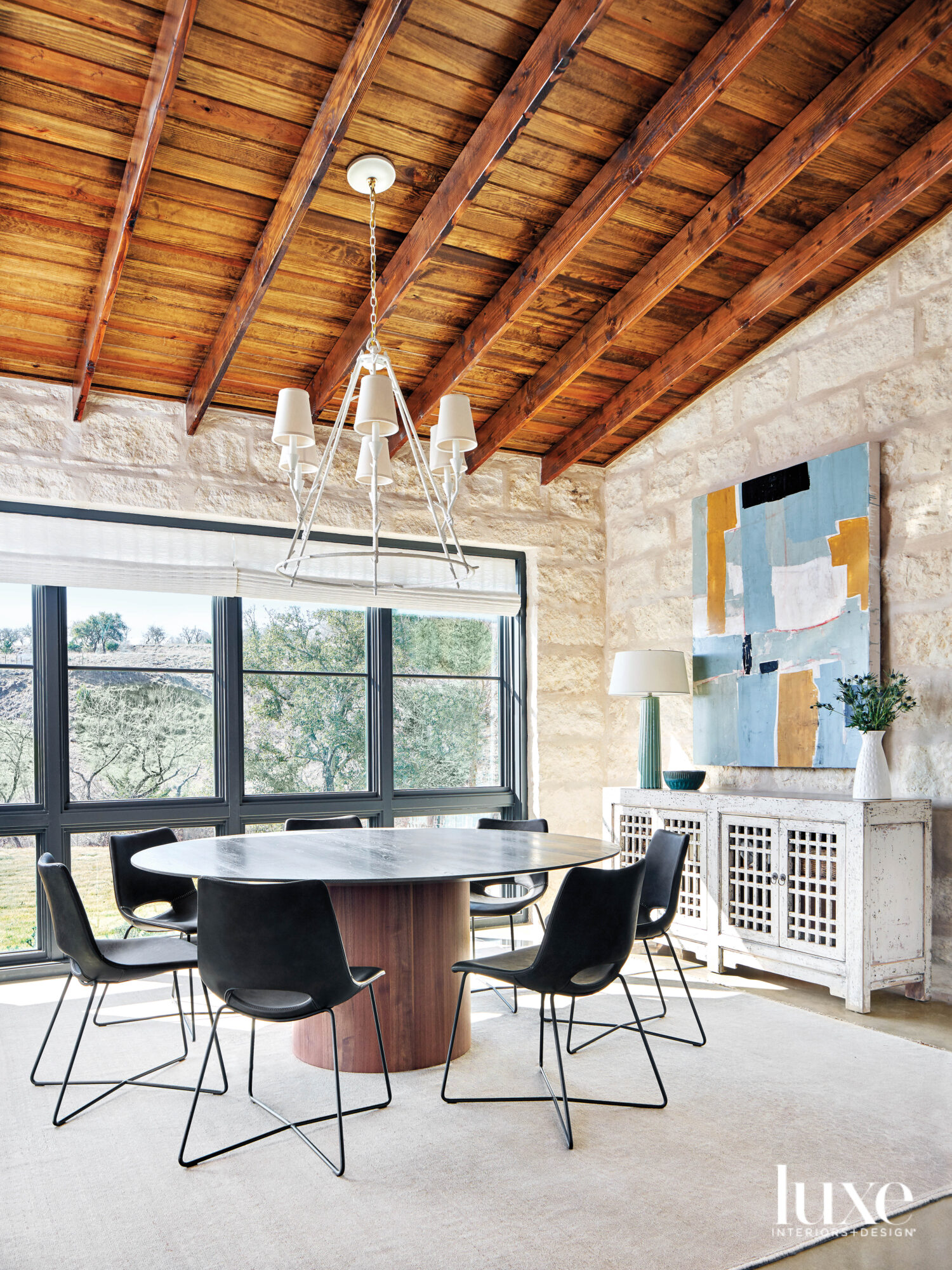 Dining room with expansive windows.