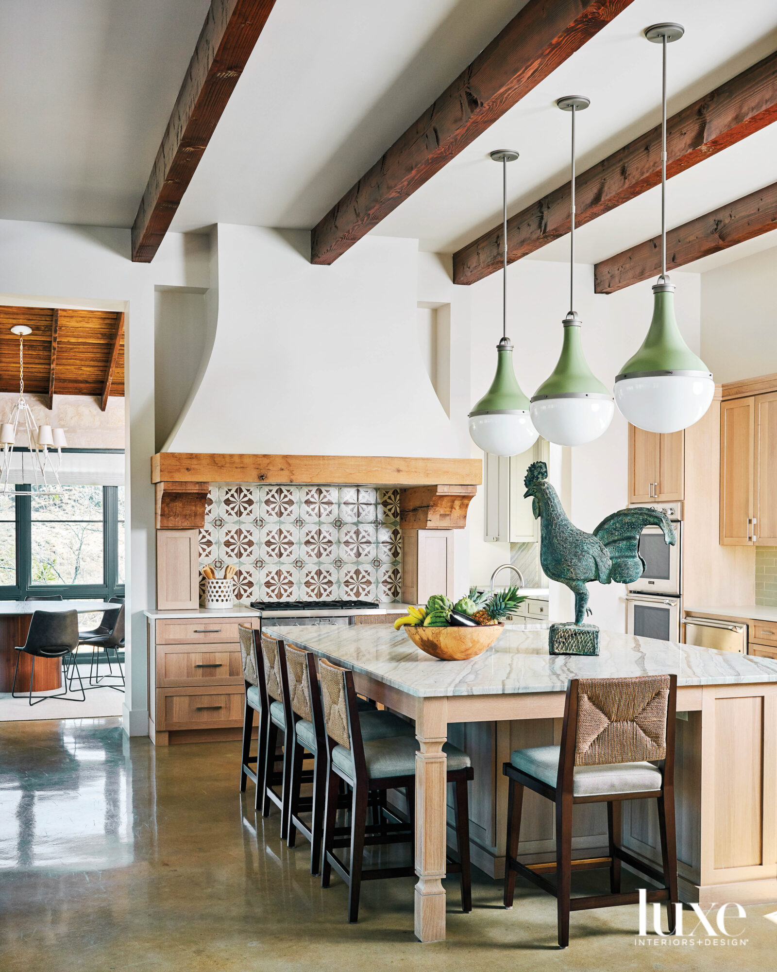 Kitchen with statement backsplash and vent hood.