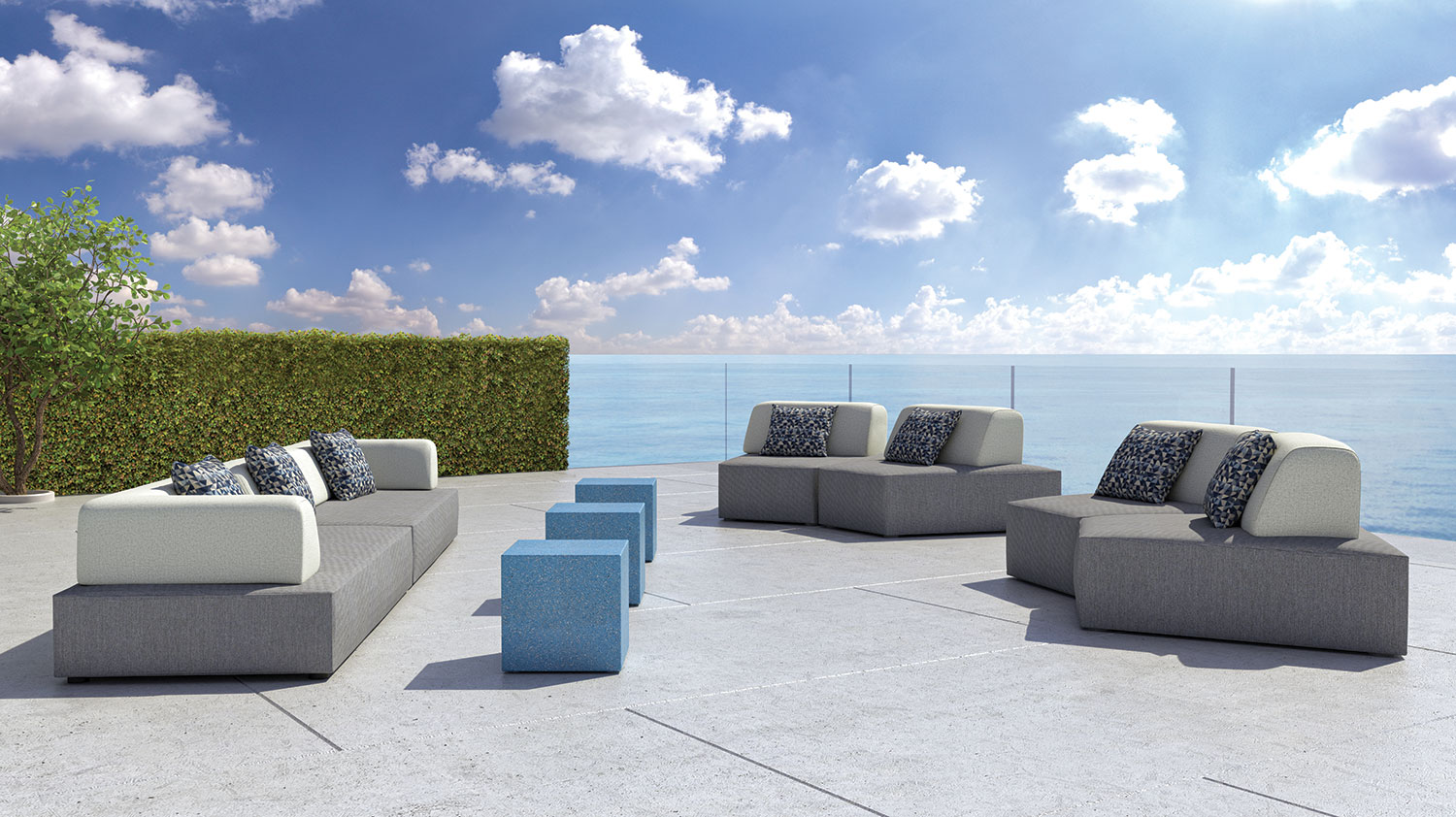 outdoor couches blue tables by water