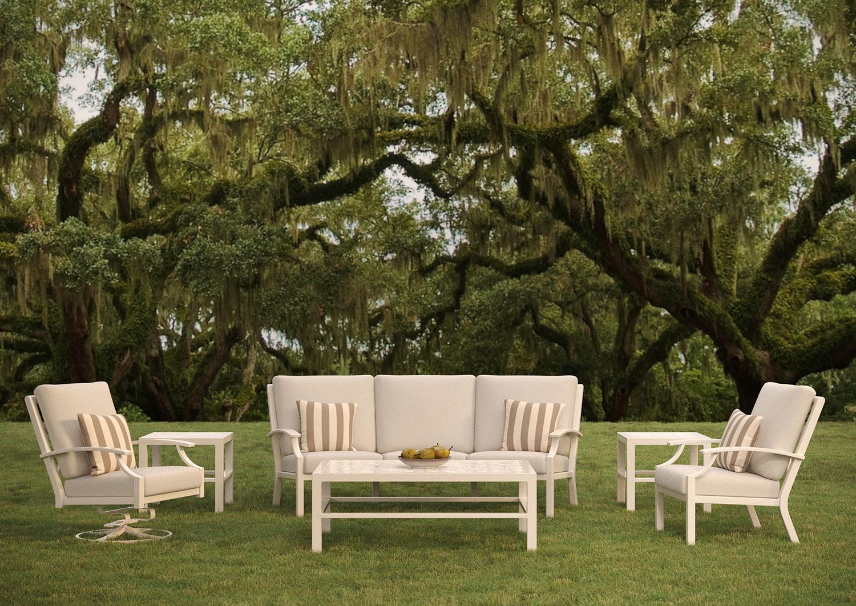 tropitone furniture under trees