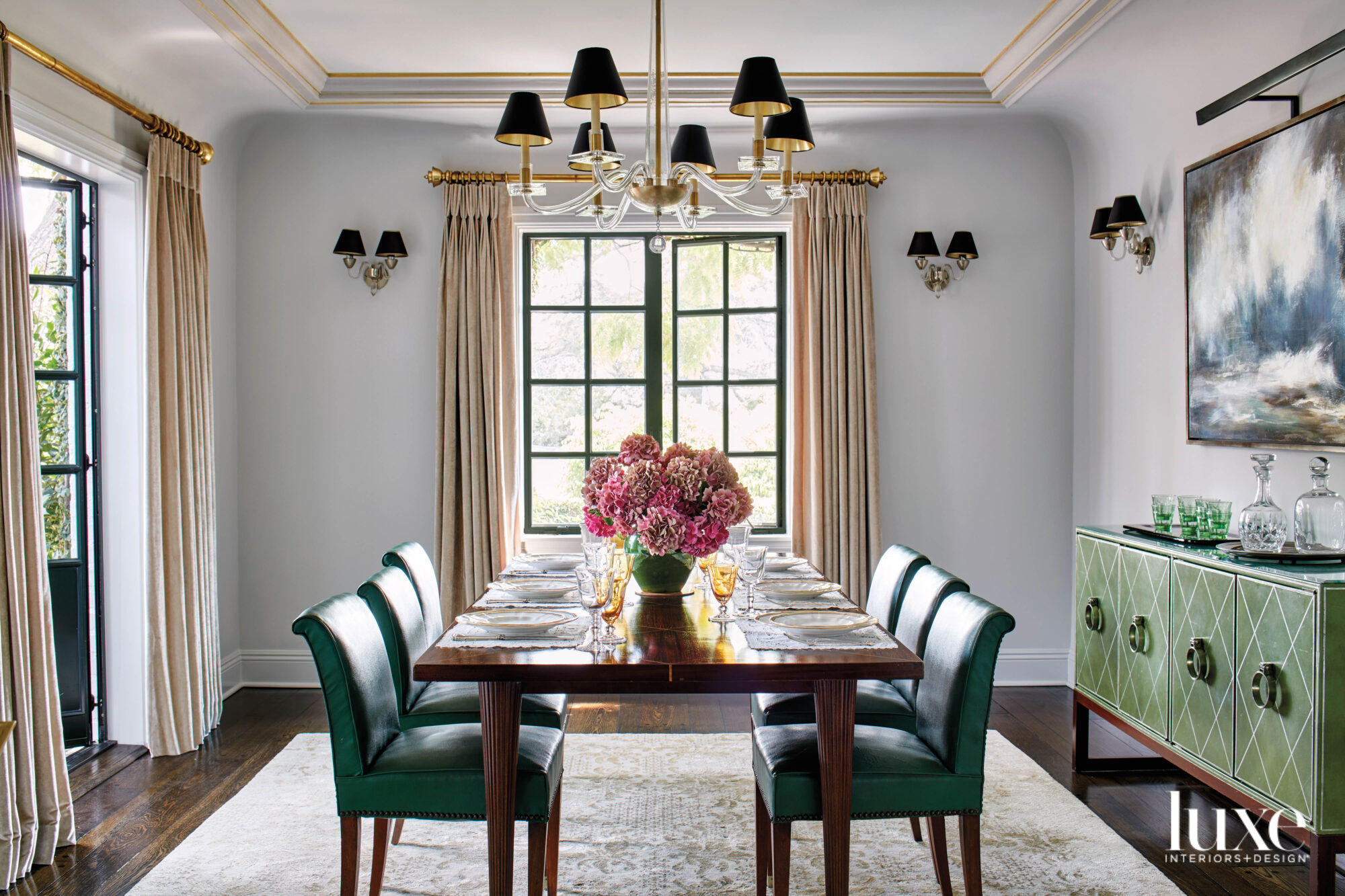 Dining room with green chairs...