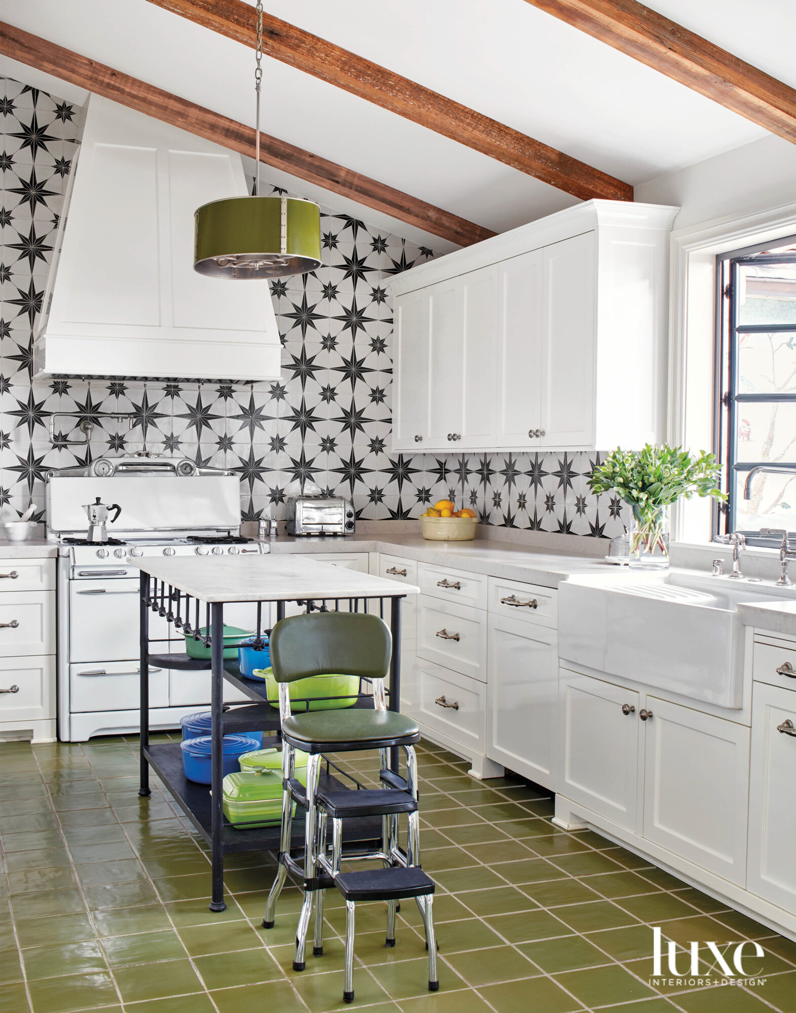Kitchen with green tile floor...
