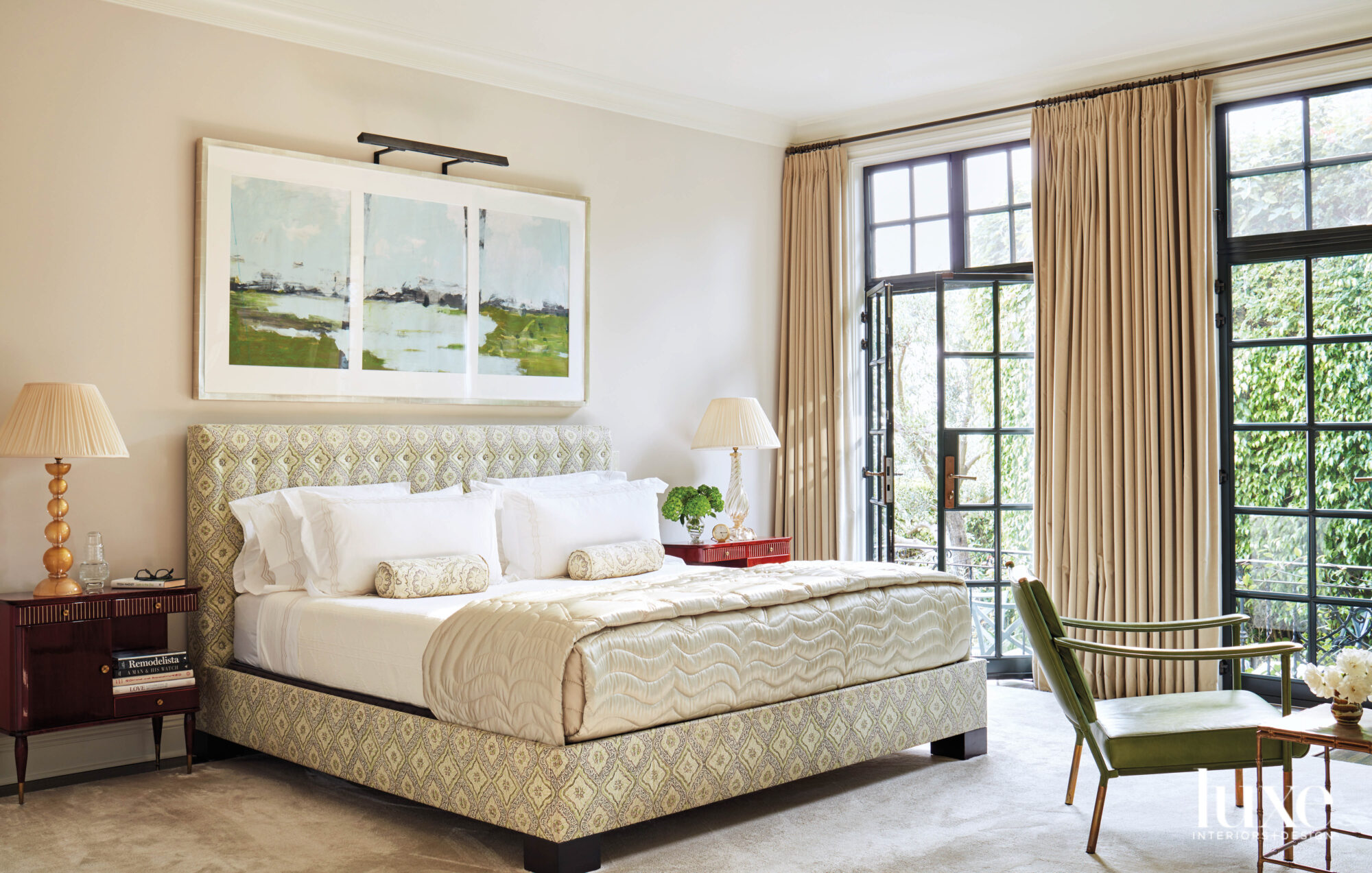 Bedroom with upholstered bed and...