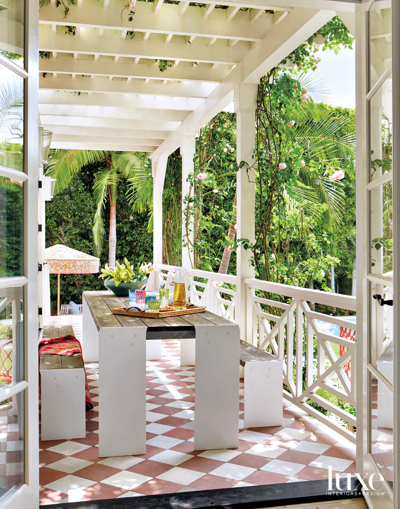 Covered patio with dining table...