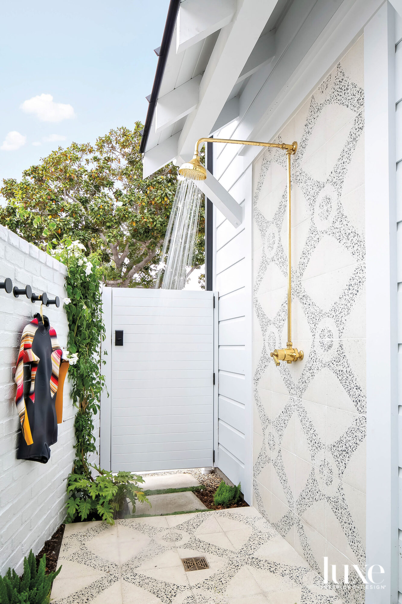 Outdoor shower with pebble-tile accent...