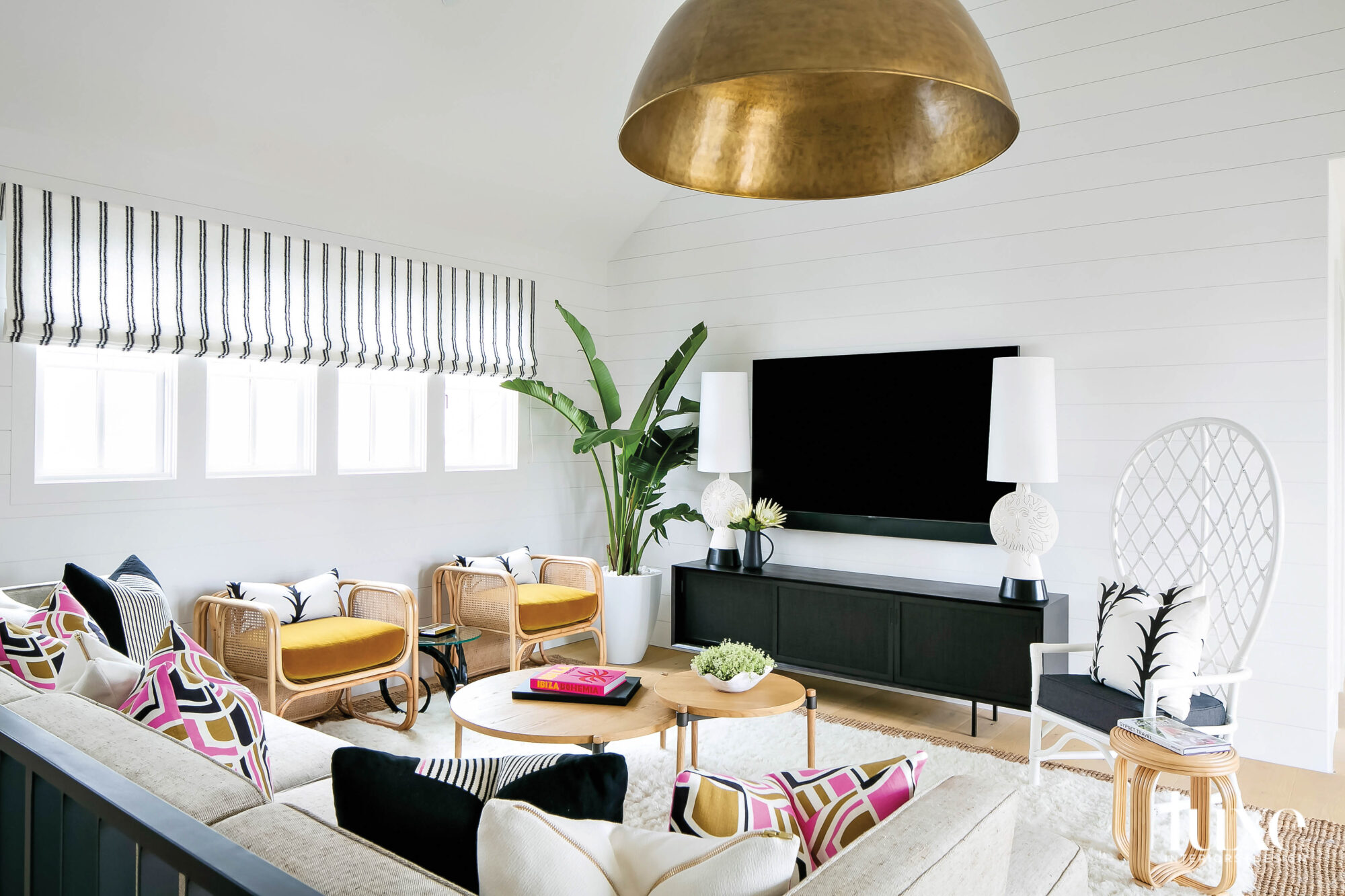 Den with gold overhead fixture...