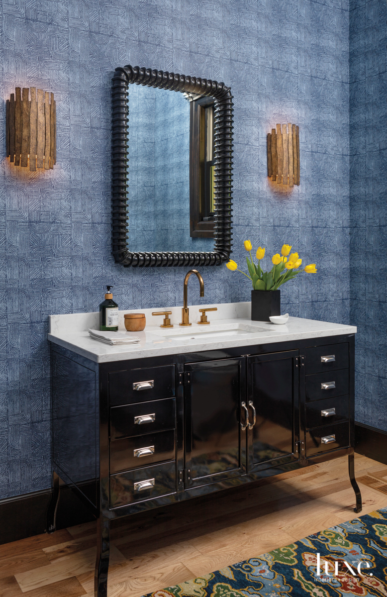 blue powder room with patterned...