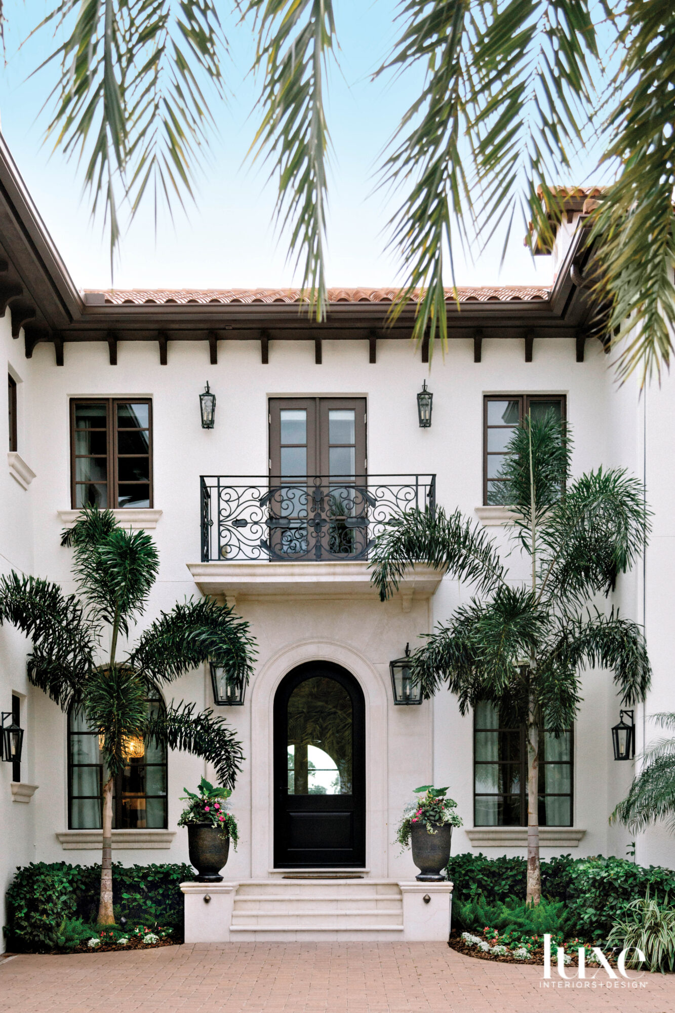 Mediterranean-style exterior of home with...