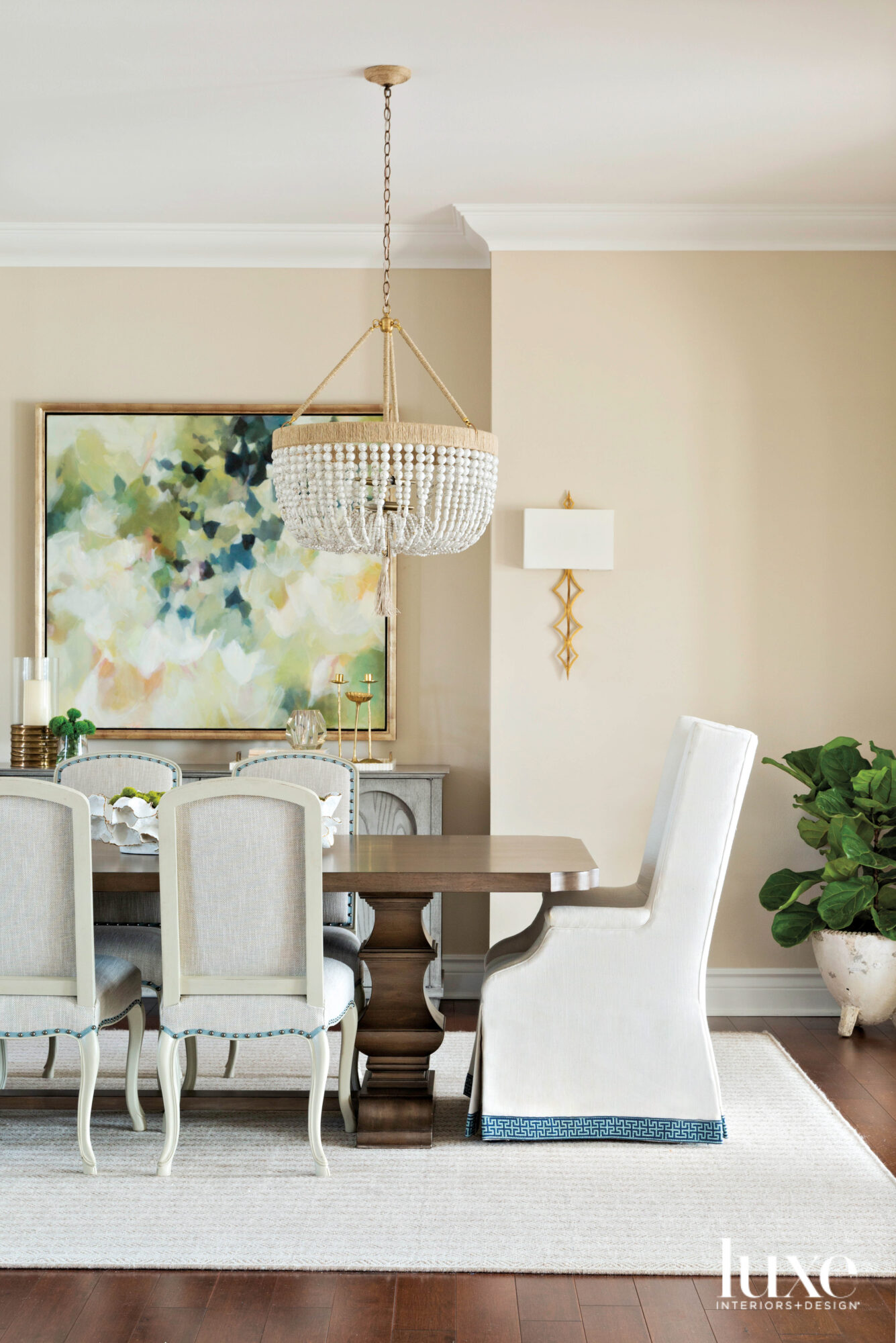 Dining room with beaded chandelier,...