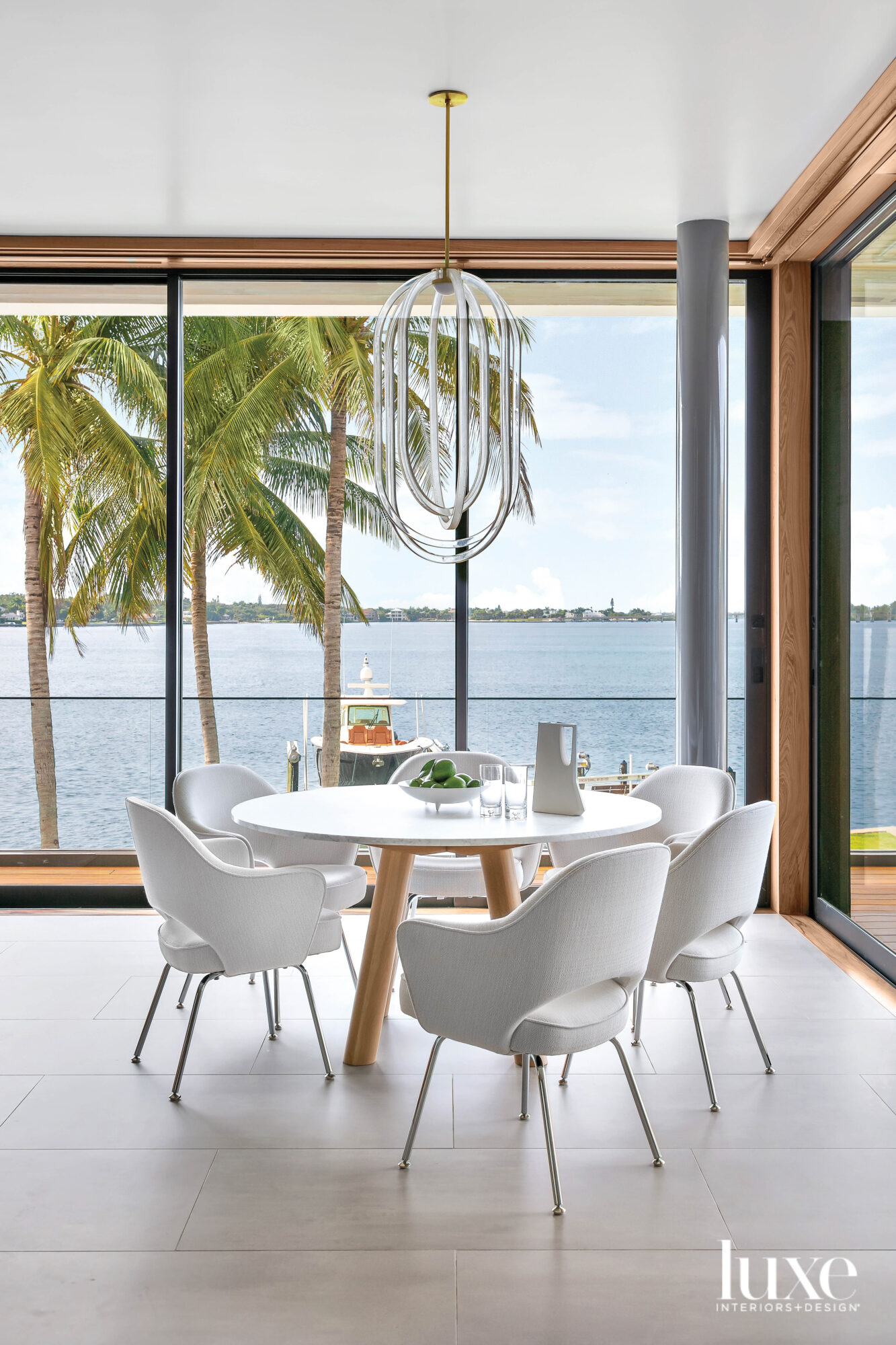 Breakfast nook with white table...