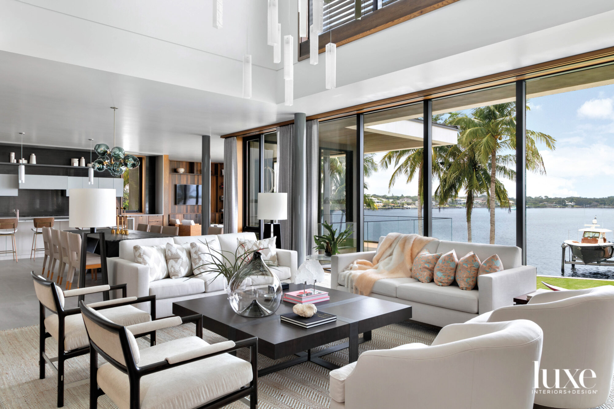 Living room with white furnishings...