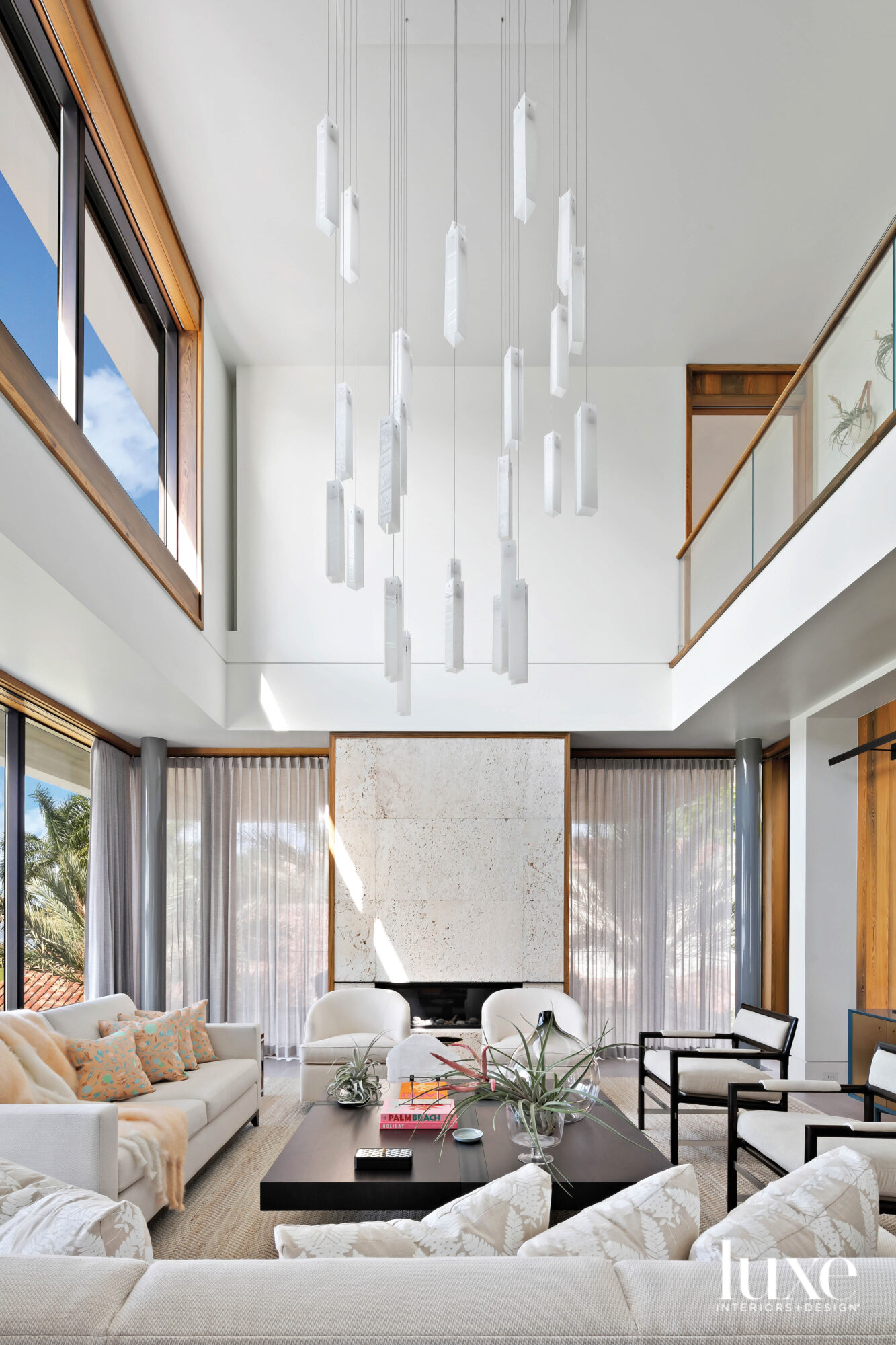 Double-height living room with chandelier...