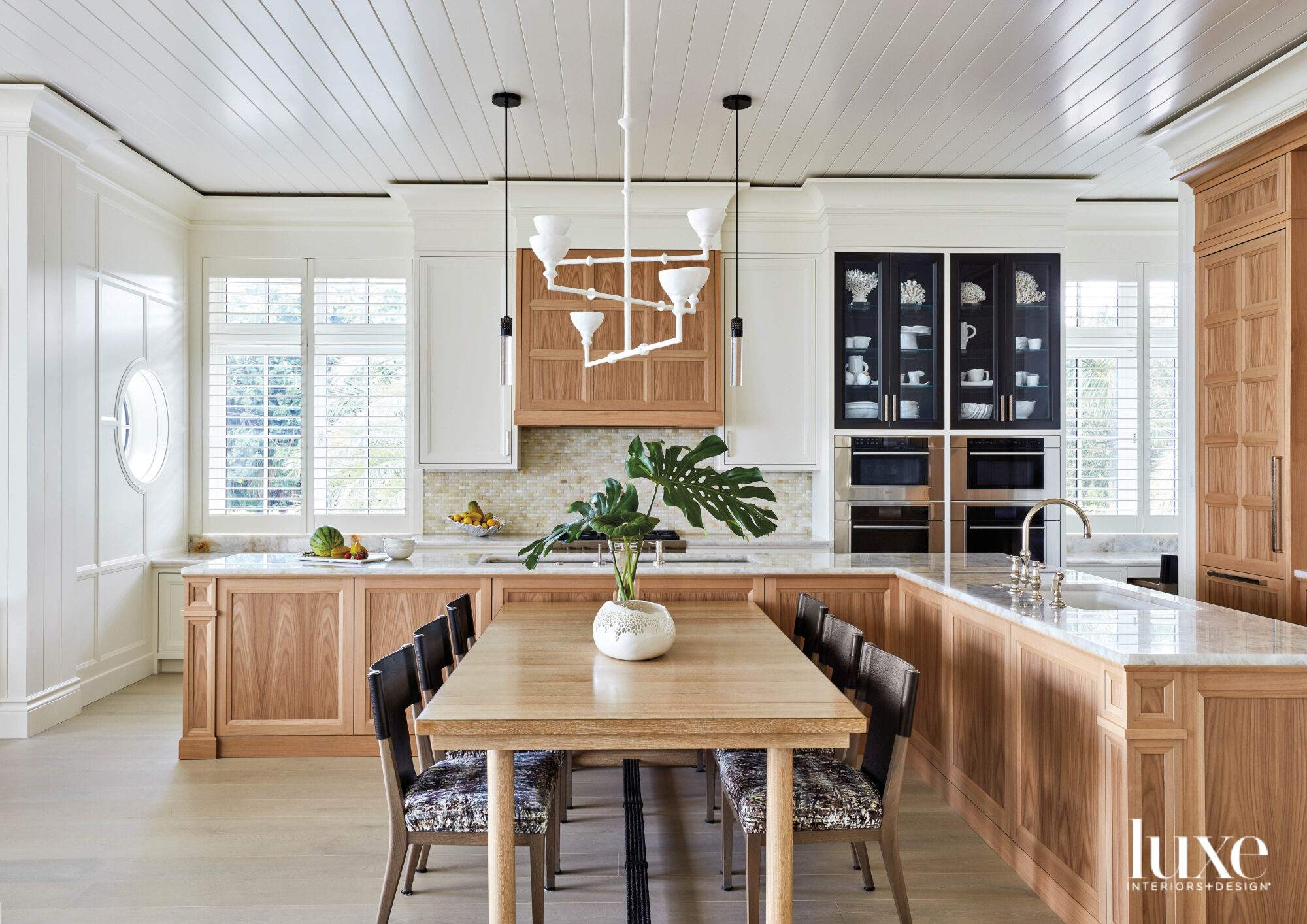 Kitchen with wood cabinetry and...