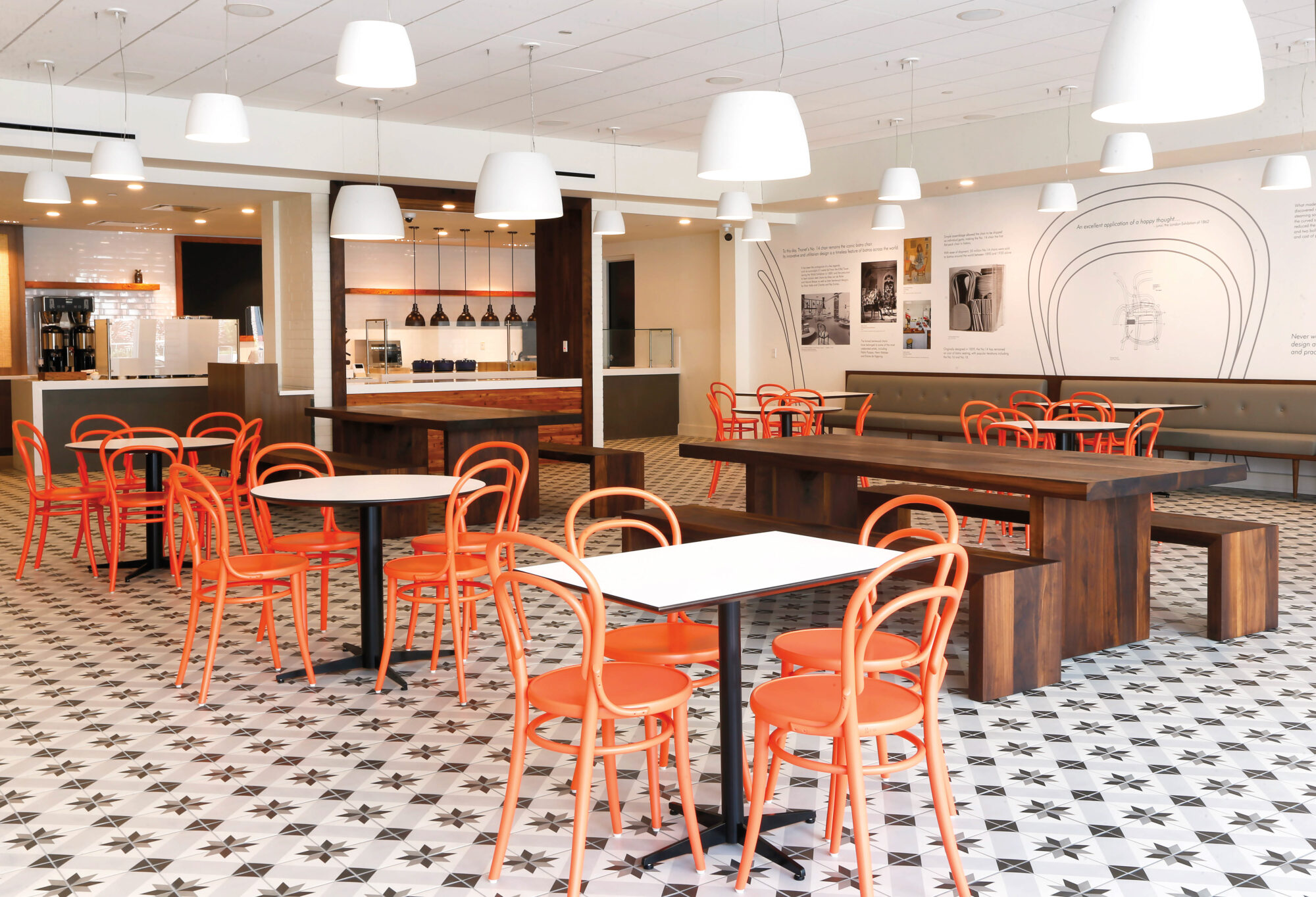 Eatery with orange chairs and wood tables