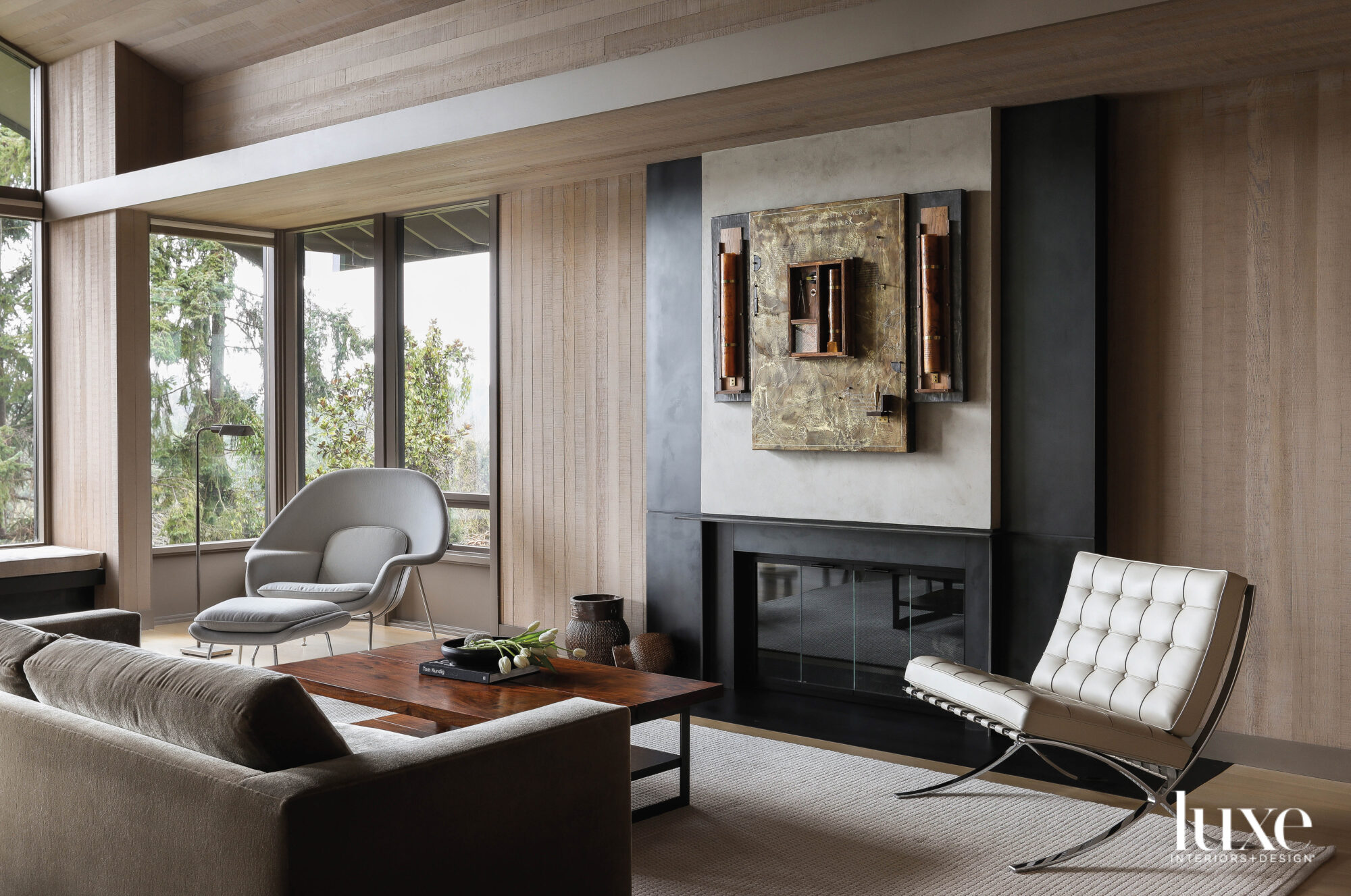 Living room with seating flanking...