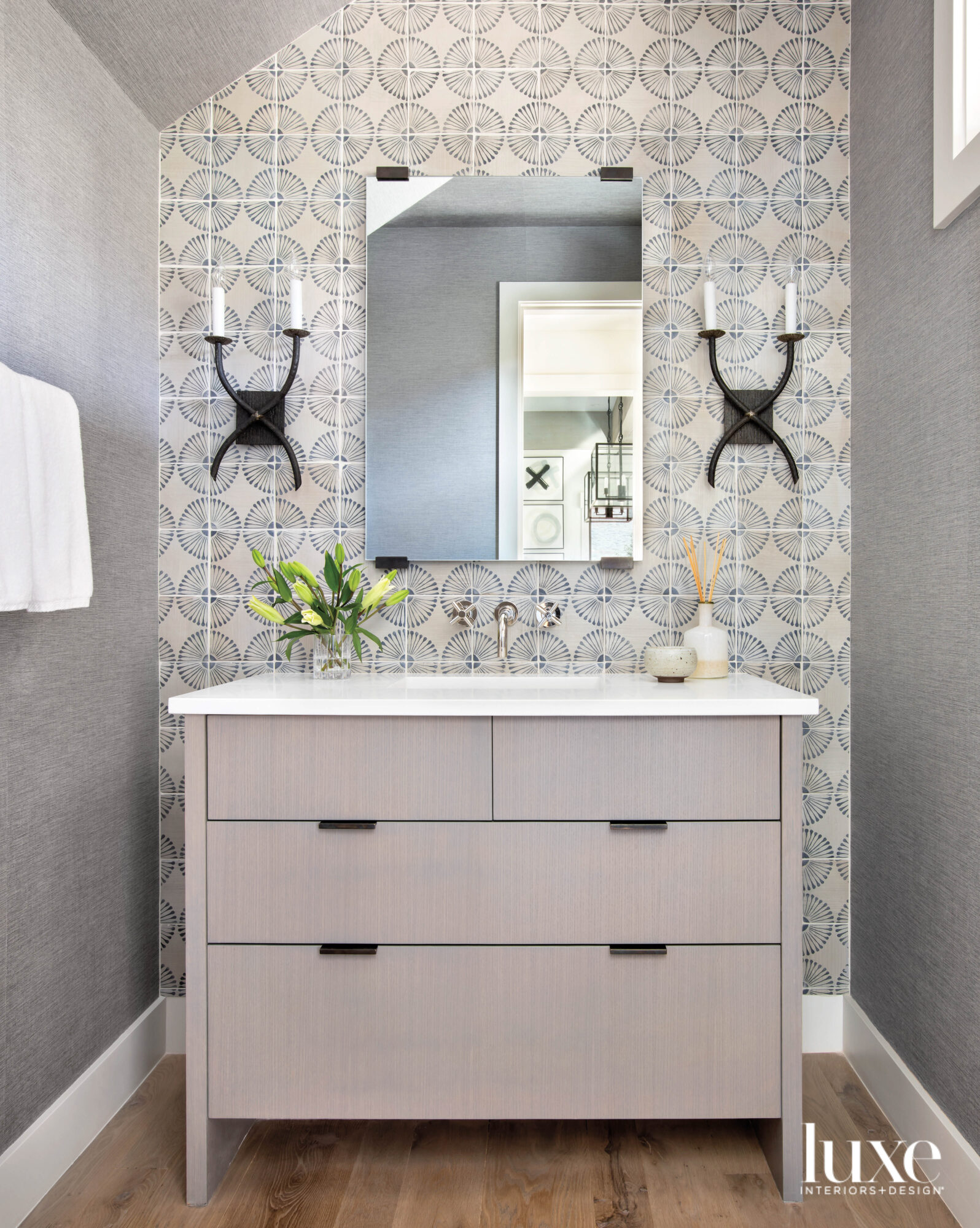 Powder room with handprinted wall...