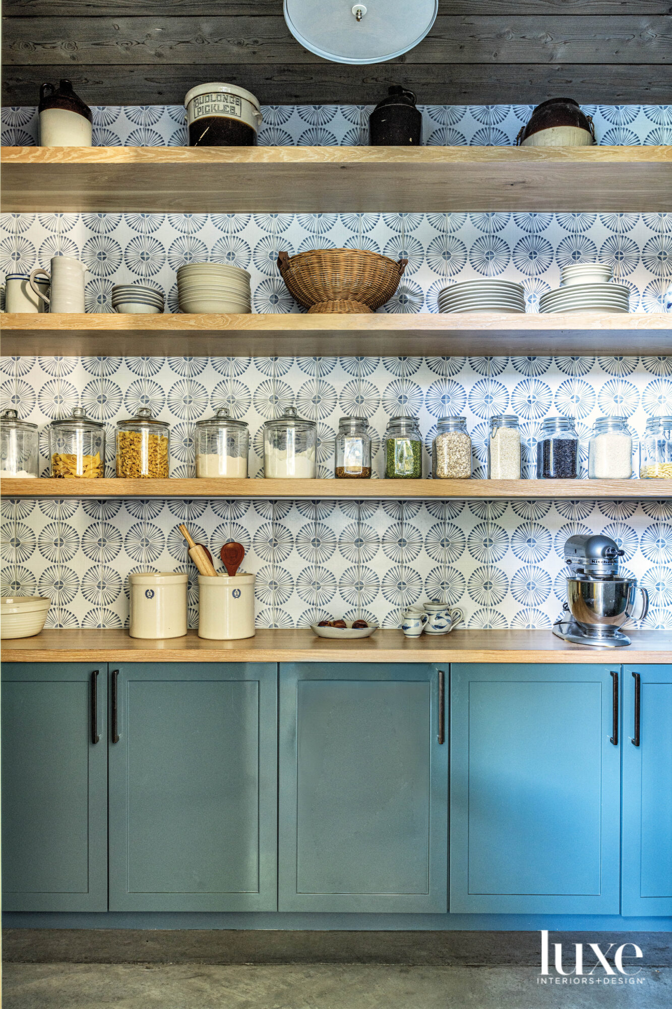 Pantry with tiled back and blue painted lower cabinets