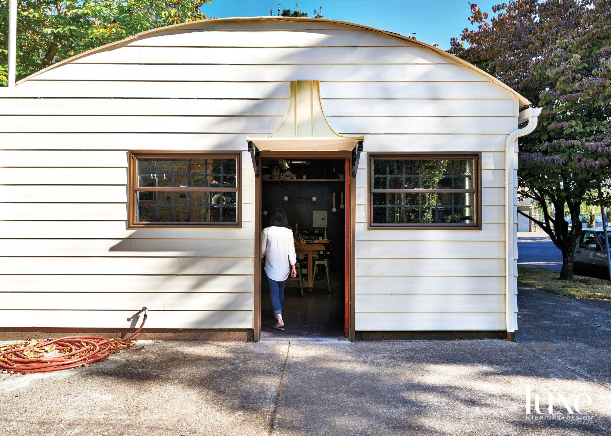 Jenny Poston walks into her Quonset hut studio in Southeast Portland