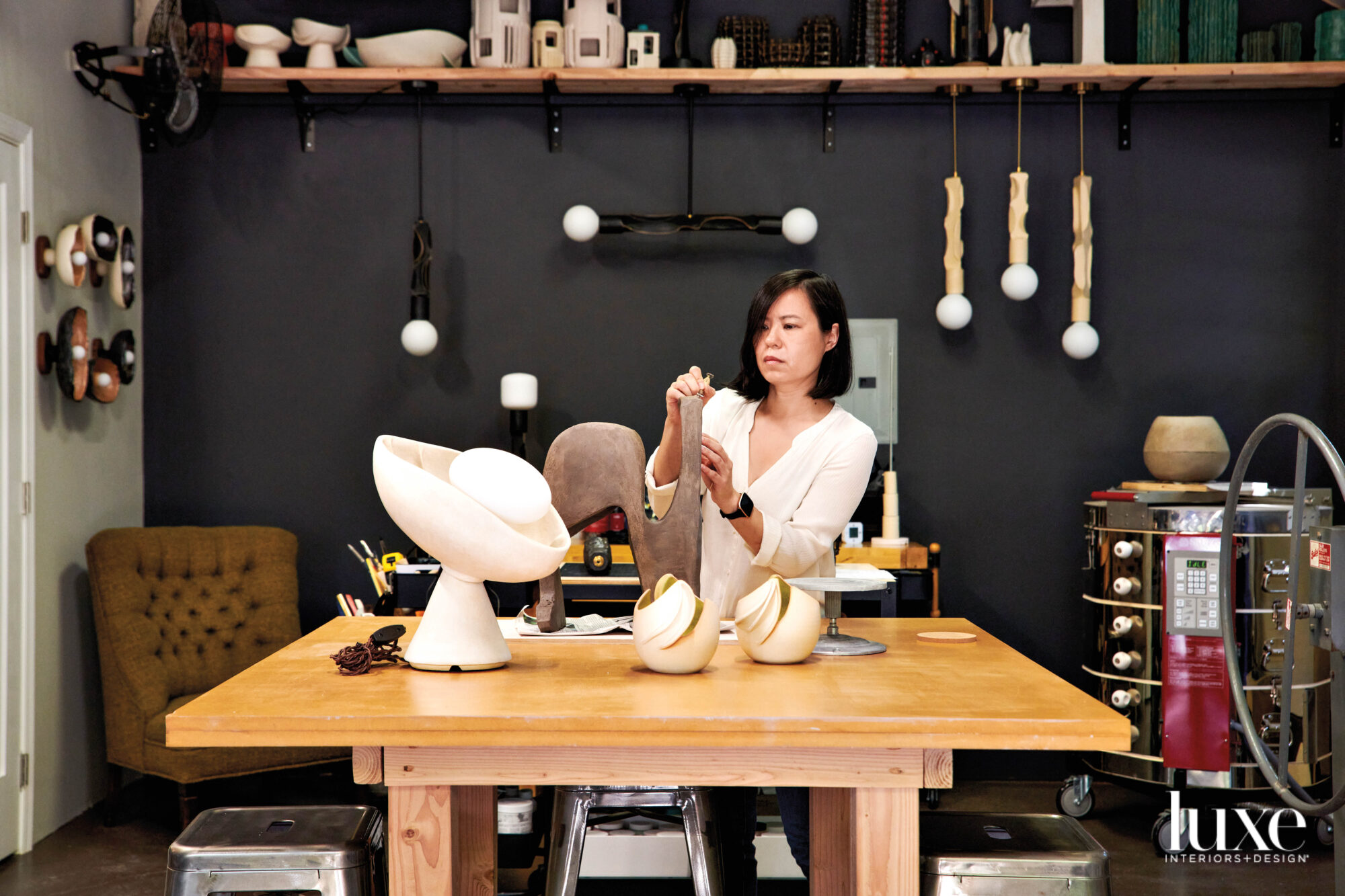 Jenny Poston in studio with lighting collection on a table