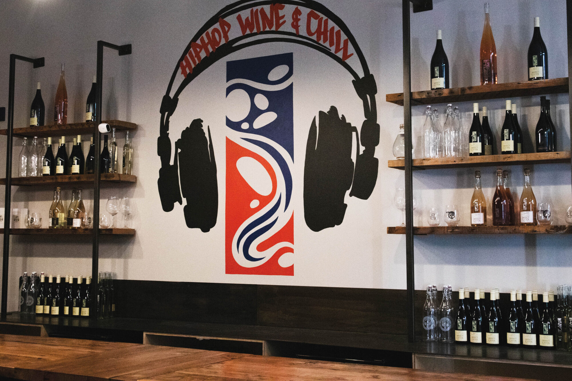 Headphone wall art in a wine shop