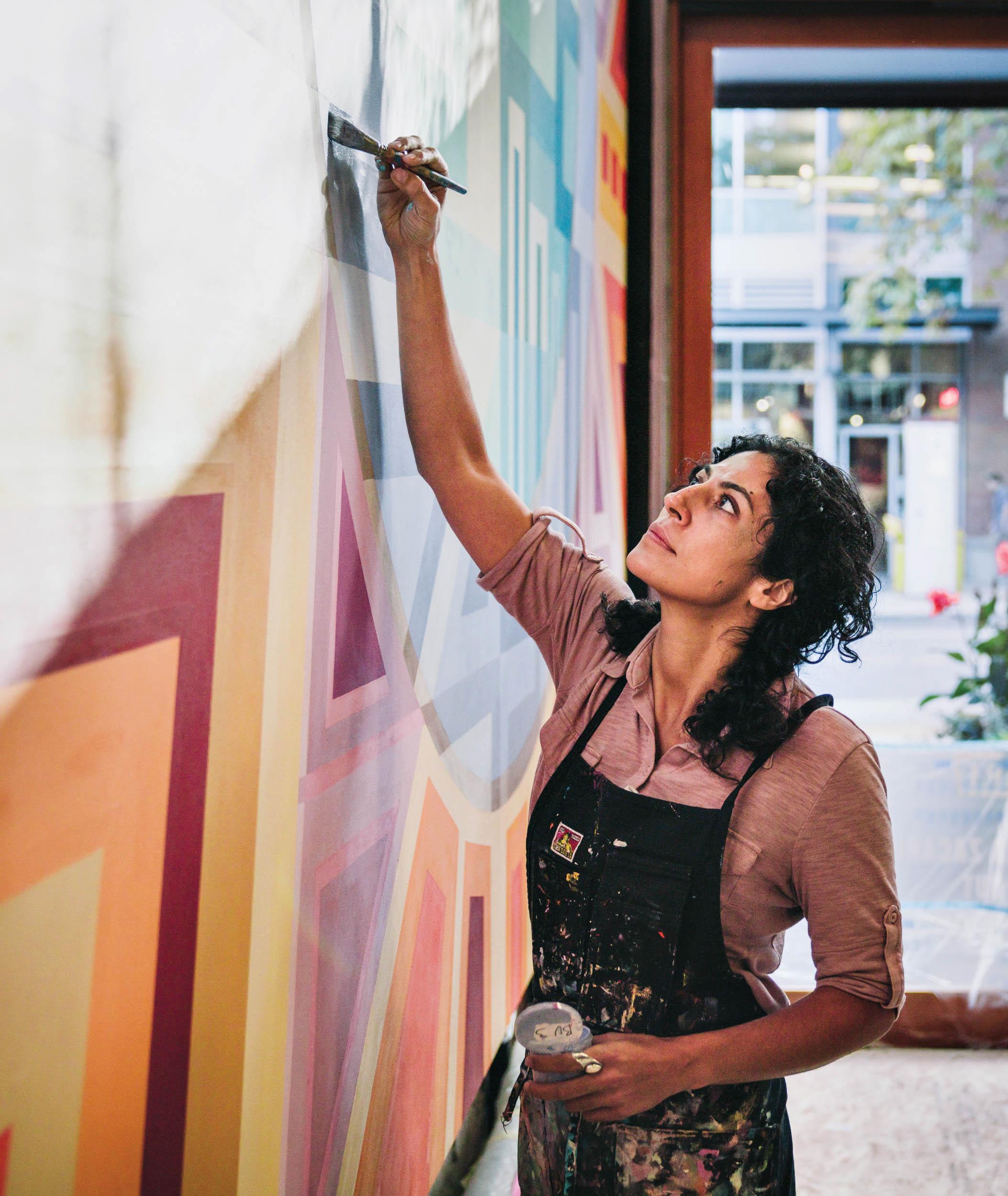 Artist Marela Zacarias painting