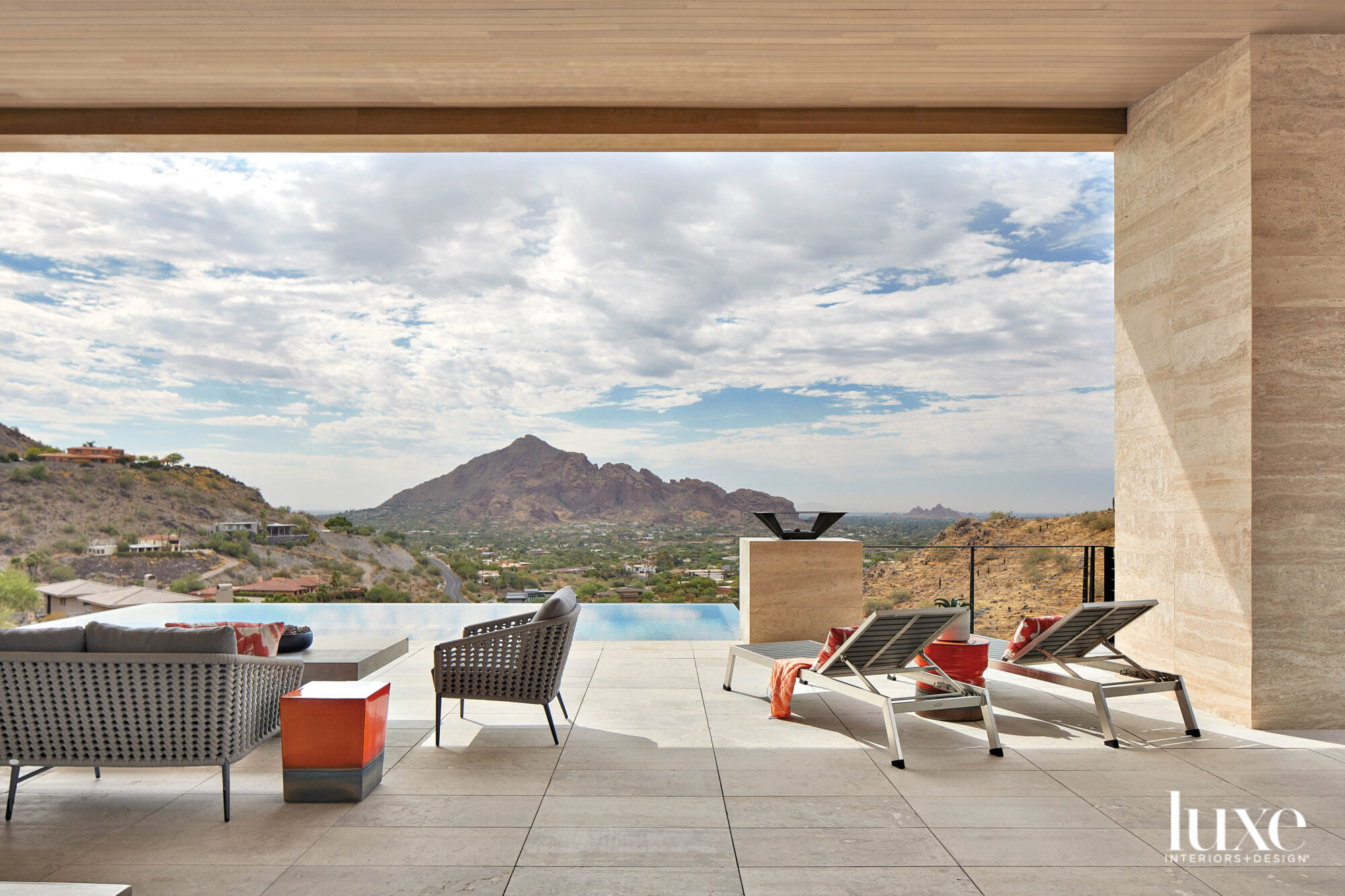 A poolside deck that looks...