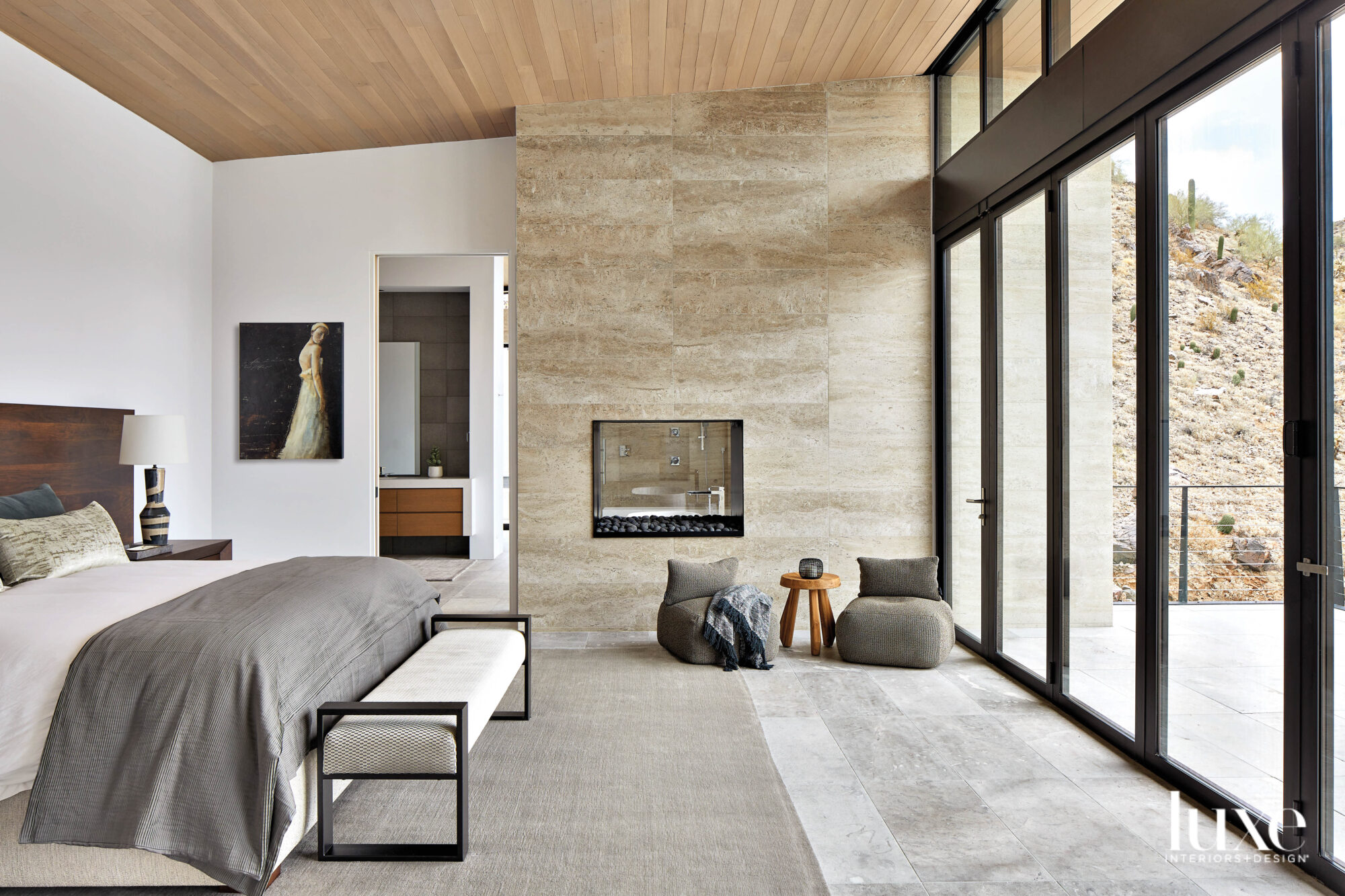 A neutral bedroom with limestone...