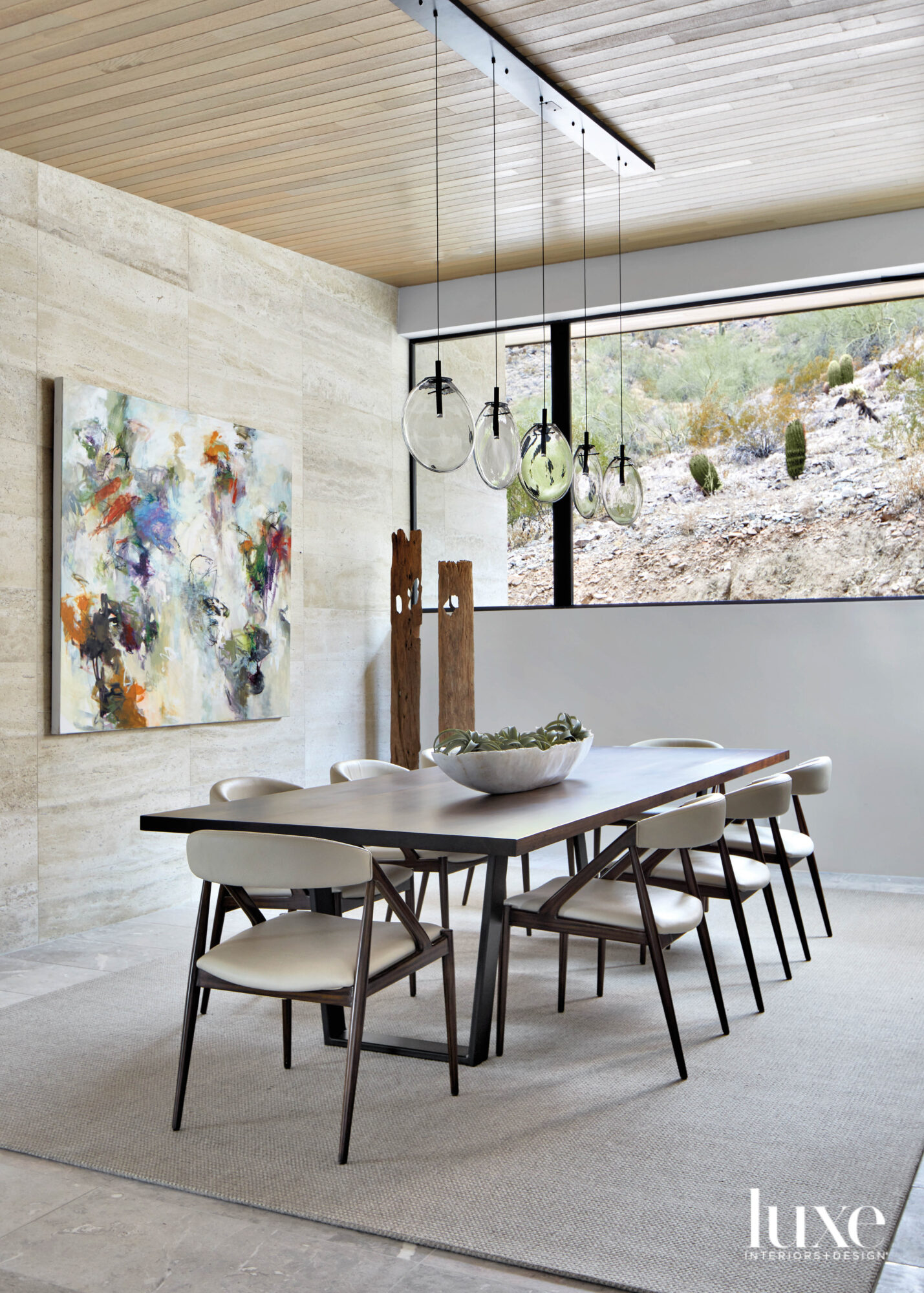 A neutral dining room with...
